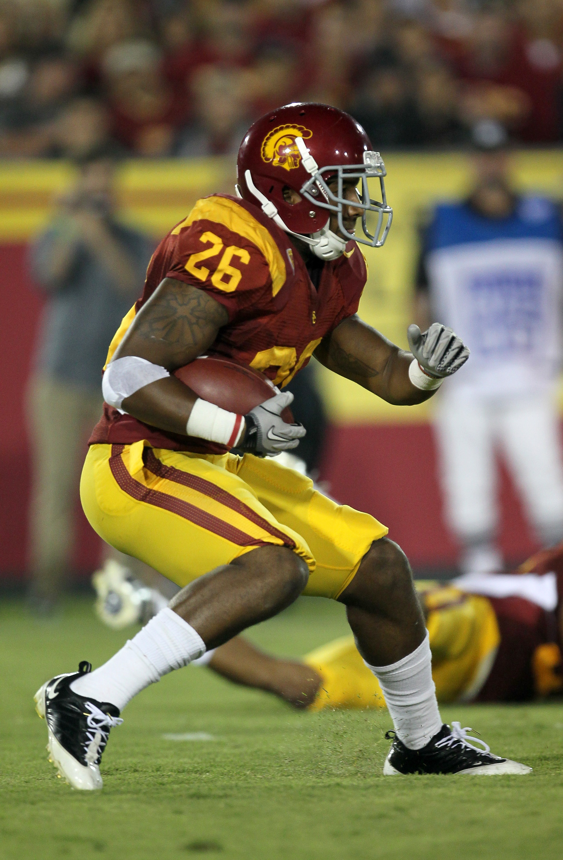 LOS ANGELES, CA - SEPTEMBER 11:  Running back Marc Tyler #26 of the USC Trojans carries the ball against the Virginia Cavaliers at Los Angeles Memorial Coliseum on September 11, 2010 in Los Angeles, California. USC won 17-14.  (Photo by Stephen Dunn/Getty