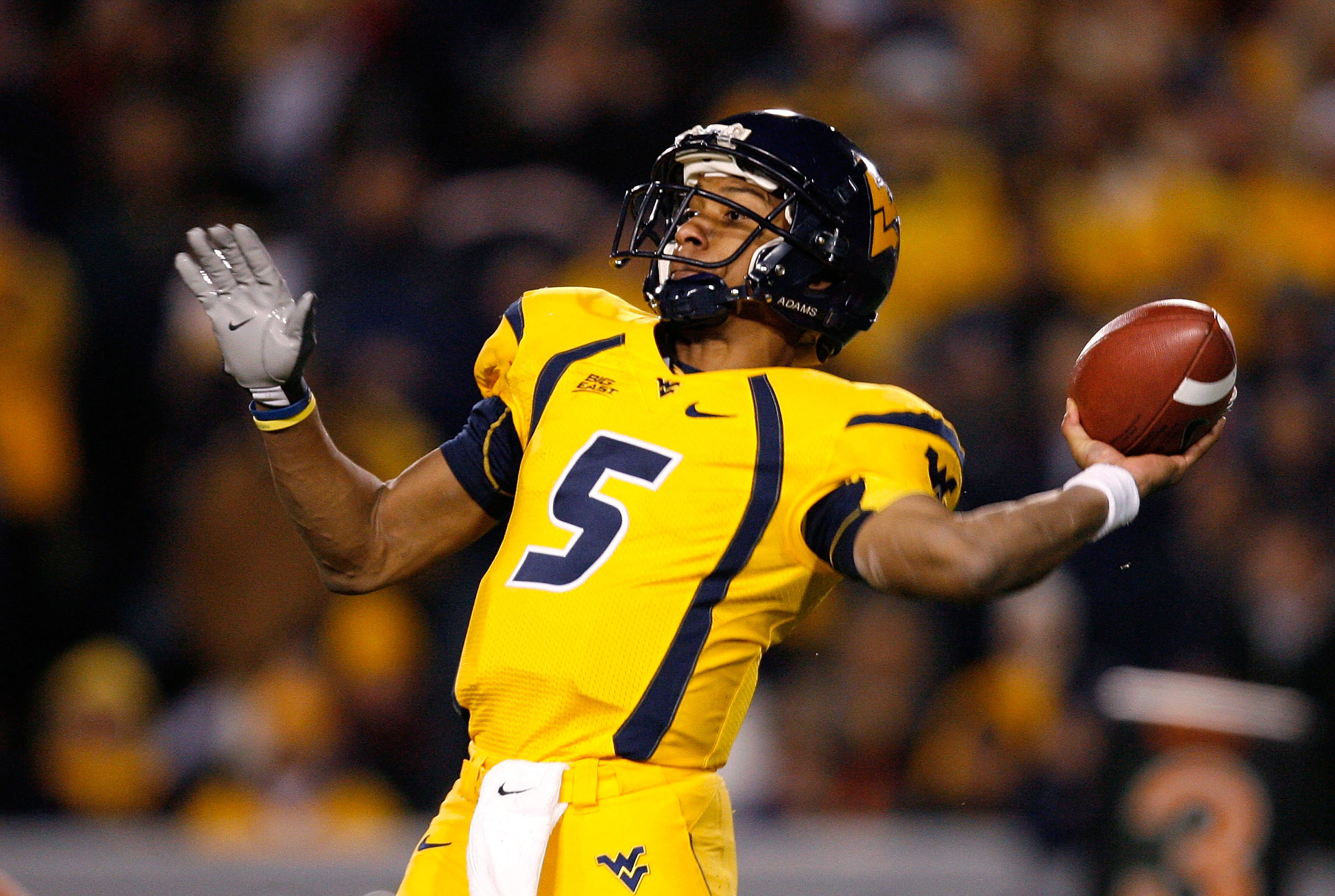 MORGANTOWN, WV - DECEMBER 1:  Quarterback Patrick White #5 of the West Virginia Mountaineers passes the ball before getting injured against the Pittsburgh Panthers during the first half at Milan Puskar Stadium December 1, 2007 in Morgantown, West Virginia