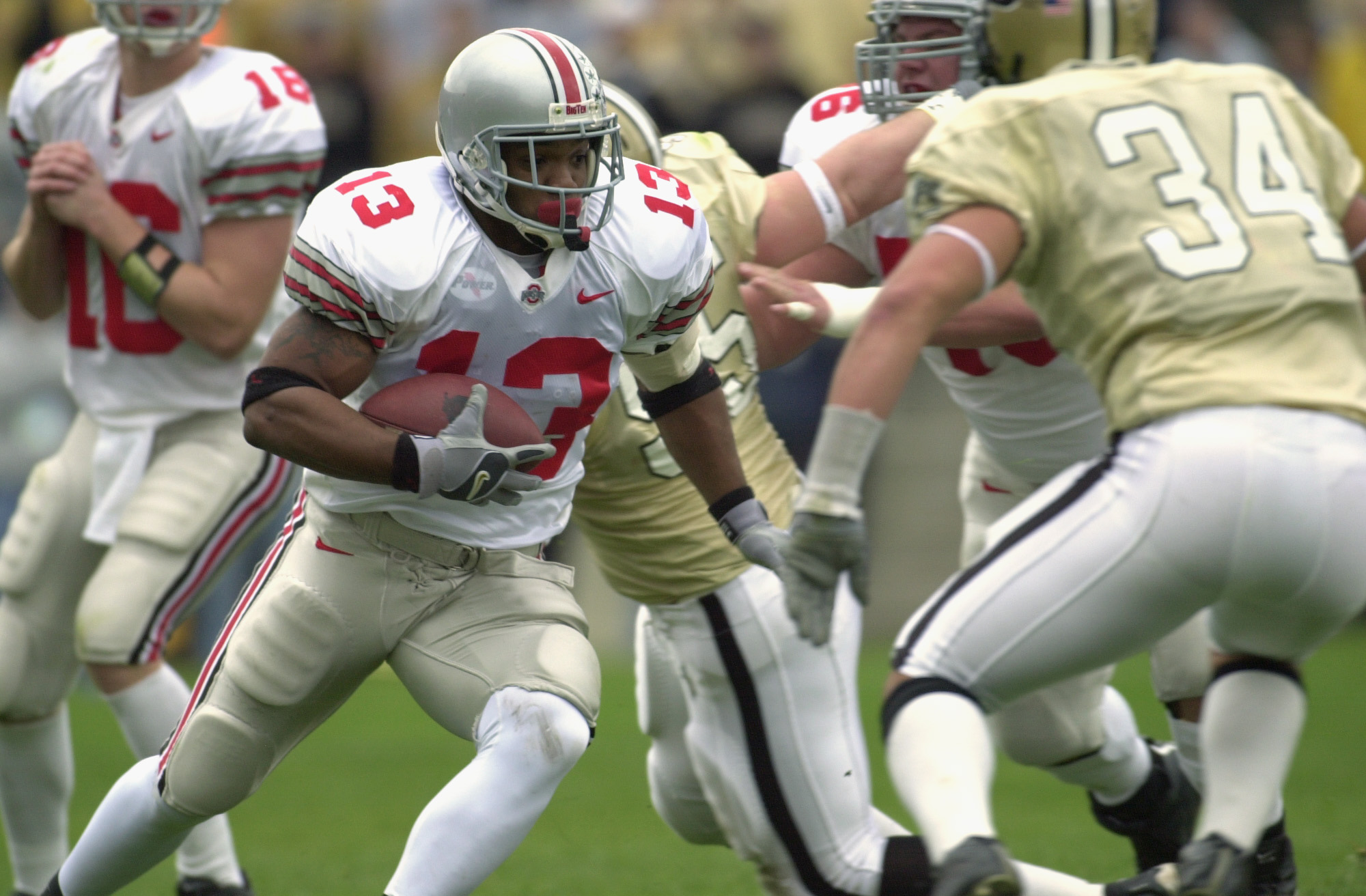 WEST LAFAYETTE, IN - NOVEMBER 9:  Tailback Maurice Clarett #13 of the Ohio State Buckeyes runs with the ball during the Big 10 Conference football game against the Purdue Boilermakers at Ross-Ade Stadium on November 9, 2002 in West Lafayette, Indiana. (Ph