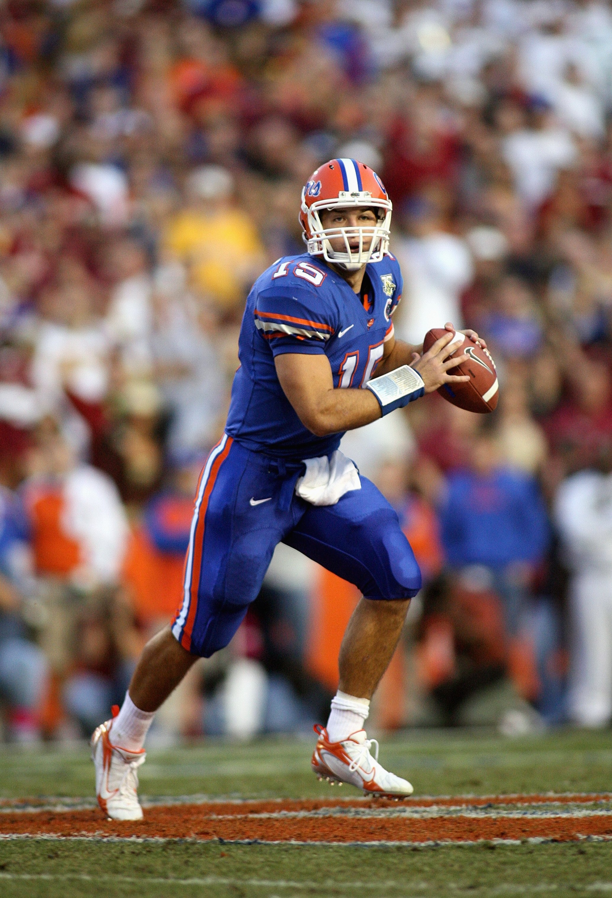GAINESVILLE, FL - NOVEMBER 24: Quarterback Tim Tebow #15 of the Florida Gators rolls out against the Florida State Seminoles at Ben Hill Griffin Stadium November 24, 2007 in Gainesville, Florida. (Photo by Marc Serota/Getty Images)