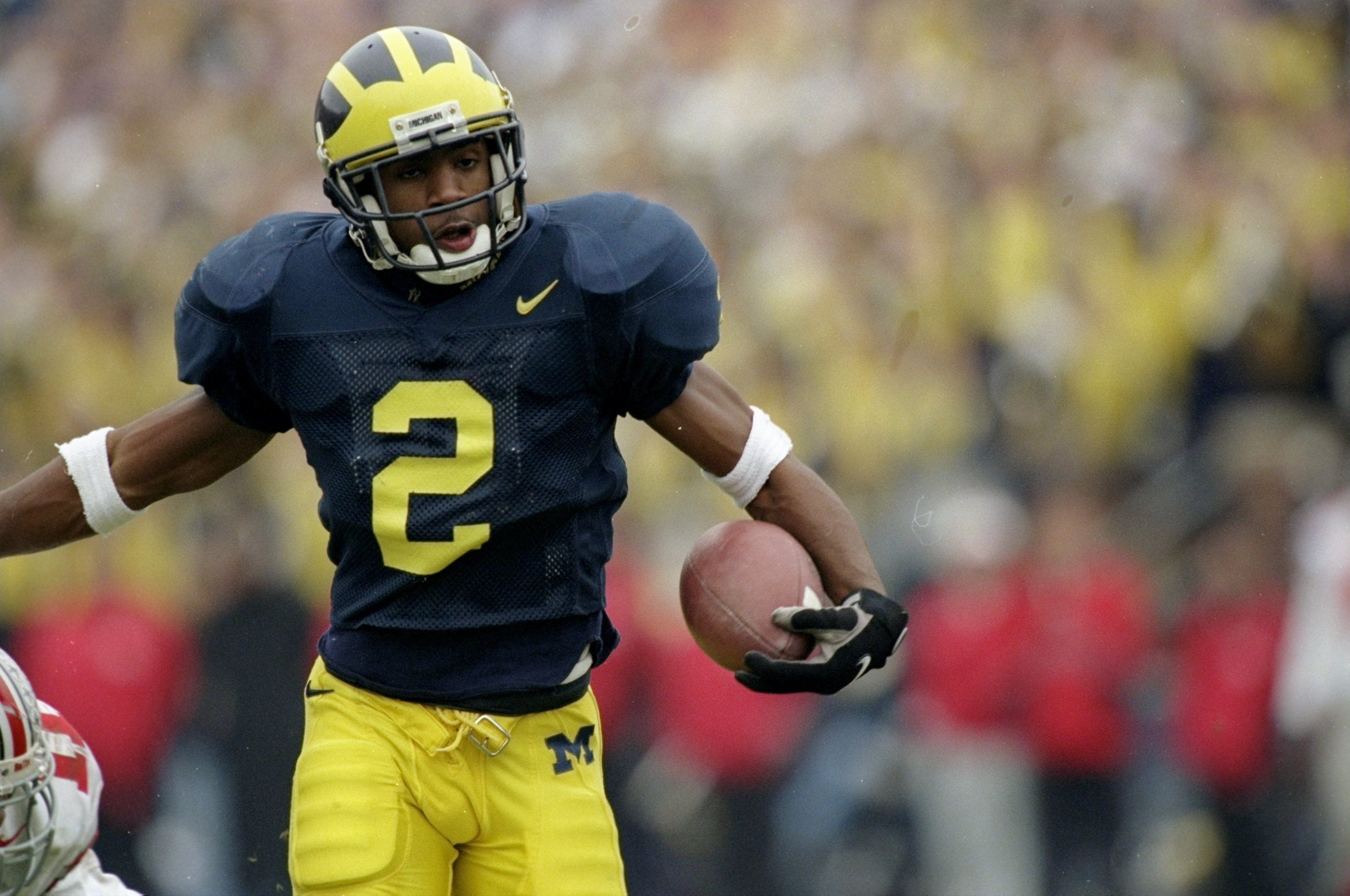 22 Nov 1997:  Charles Woodson #2 of Michigan in action on during a game against Ohio State at Michigan Stadium in Ann Arbor, Michigan.  Michigan defeated Ohio State 20-14. Mandatory Credit: Jonathan Daniel  /Allsport