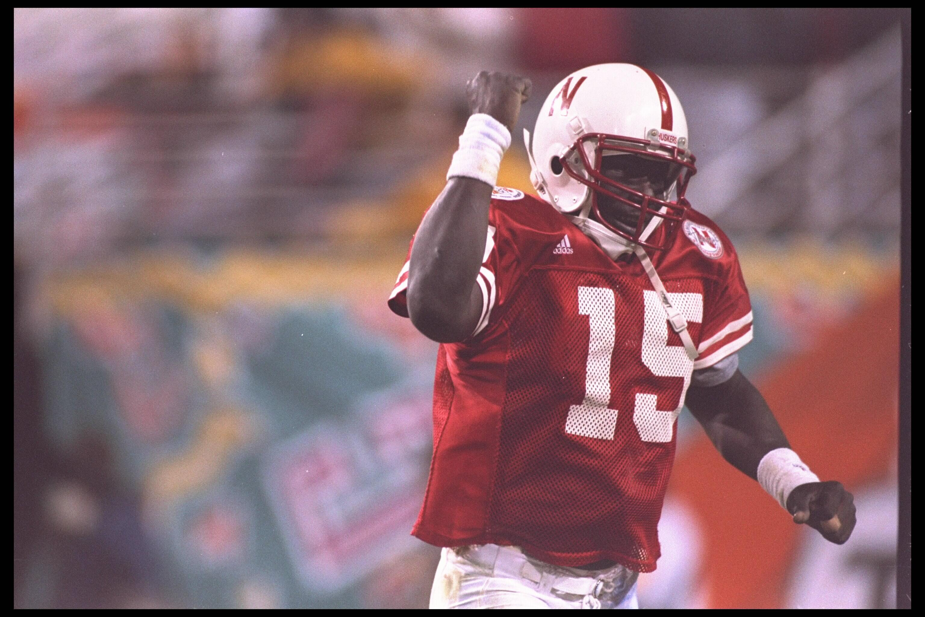 2 Jan 1996:  Quarterback Tommie Frazier #15 of the Nebraska Cornhuskers celebrates a touchdown against the Florida Gators in the Fiesta Bowl at Sun Devil Stadium in Tempe, Arizona. Nebraska defeated Florida 62-24.  Mandatory Credit:  Mike Powell/Allsport
