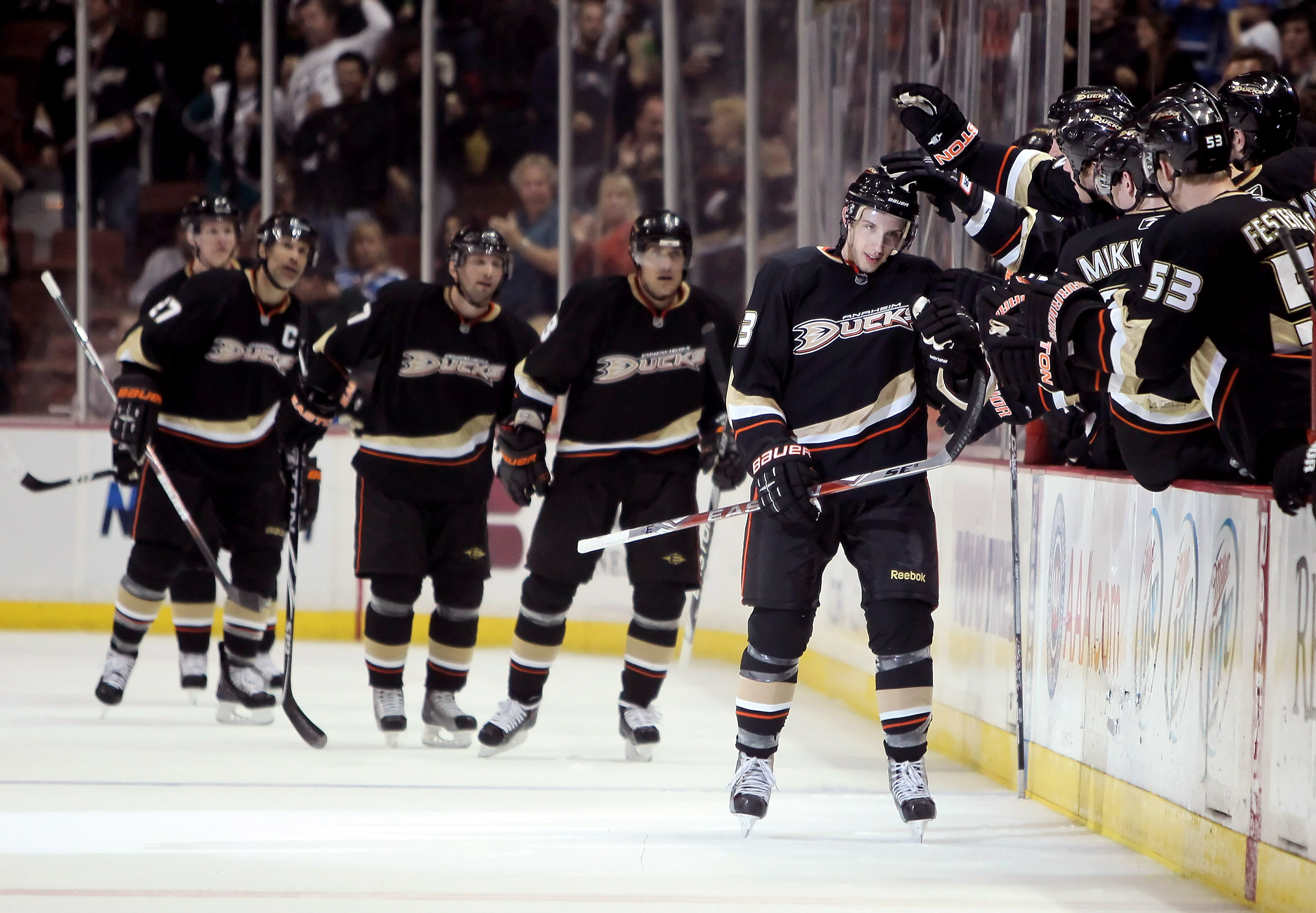 ANAHEIM, CA - MARCH 29:  Nick Bonino (R) #63 of the Anaheim Ducks receives high fives from the bench after scoring his first NHL goal in the second period against the Dallas Stars at the Honda Center on March 29, 2010 in Anaheim, California.  (Photo by Je