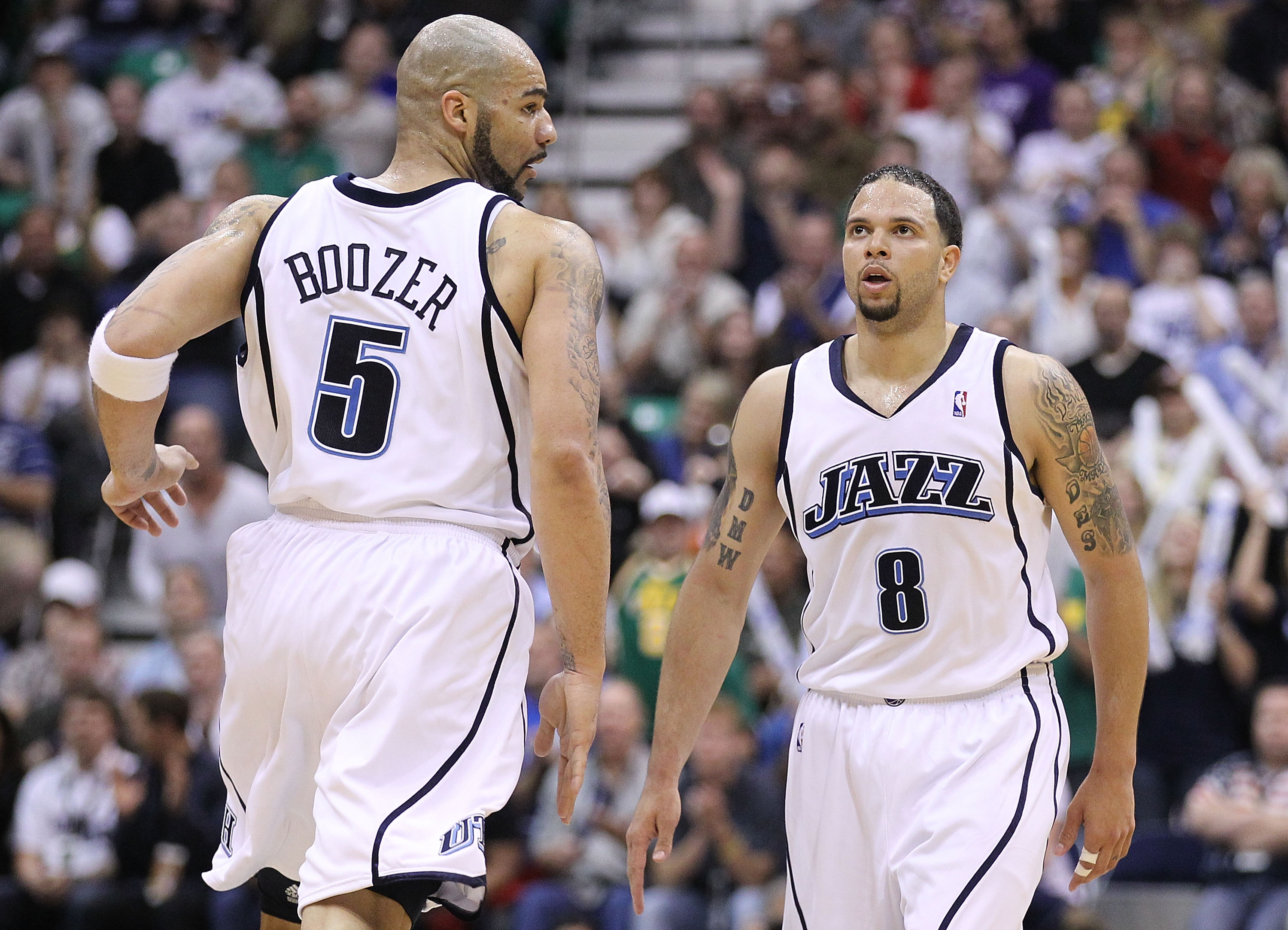 SALT LAKE CITY - MAY 10:  Deron Williams #8 and Carlos Boozer #5 of the Utah Jazz look on against the Los Angeles Lakers during Game Four of the Western Conference Semifinals of the 2010 NBA Playoffs on May 10, 2010 at Energy Solutions Arena in Salt Lake
