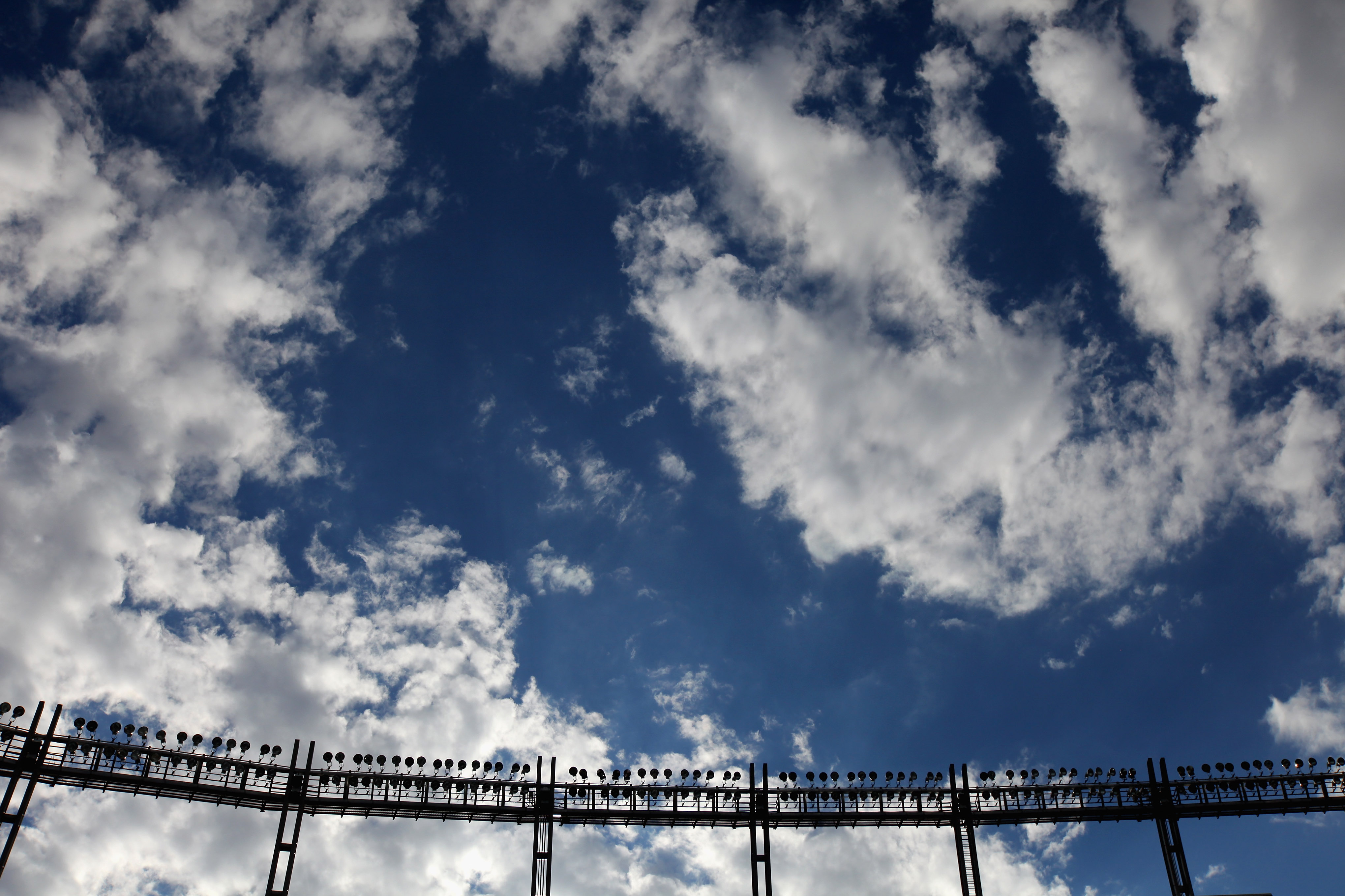 DENVER - AUGUST 21:  Stadium lights are at the ready as clouds filter the fading sun as the Denver Broncos host the Detroit Lions during preseason NFL action at INVESCO Field at Mile High on August 21, 2010 in Denver, Colorado.  (Photo by Doug Pensinger/G
