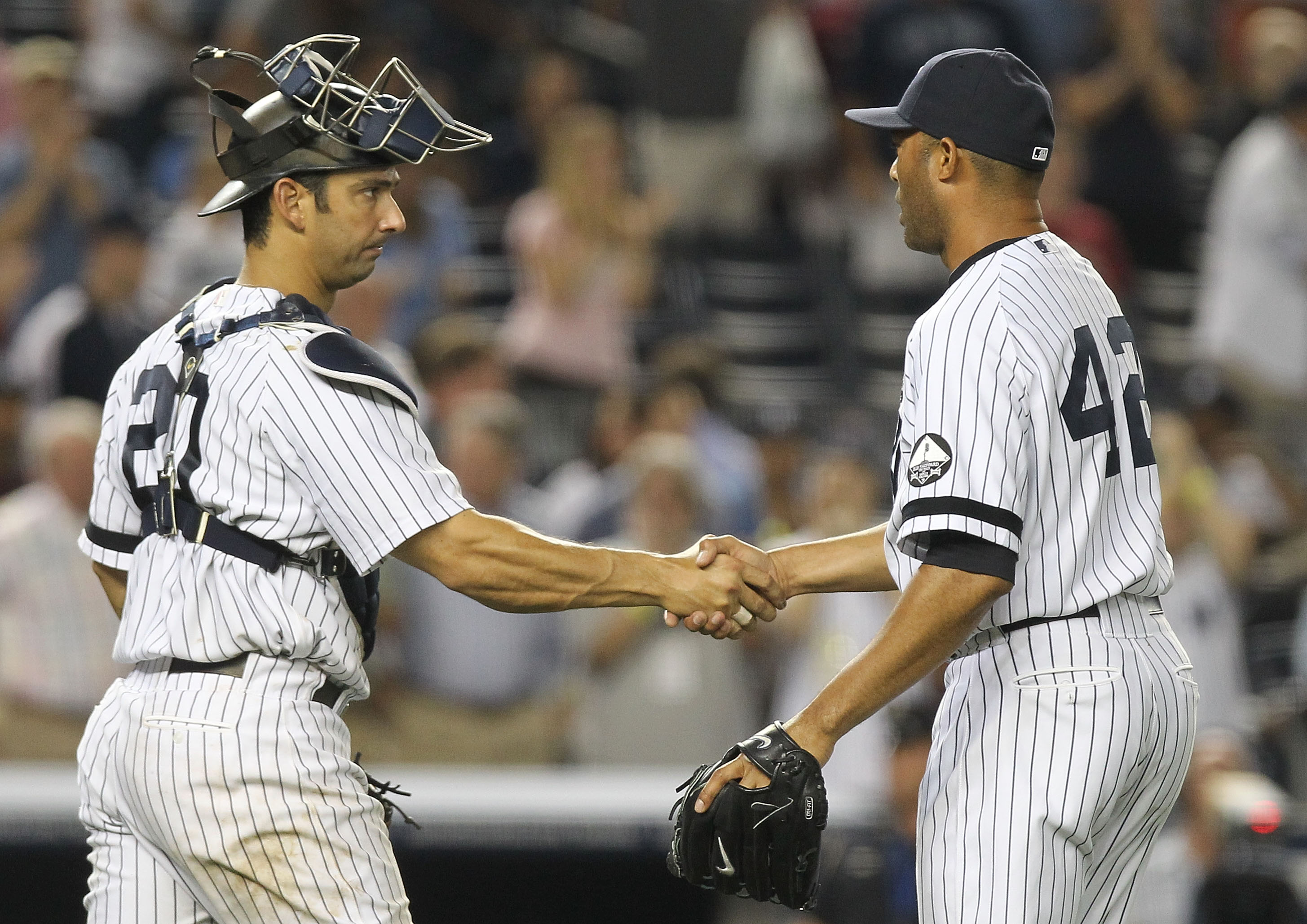 NEW YORK - AUGUST 18:  Mariano Rivera #42 of the New York Yankees celebrates the win with catcher Jorge Posada #20 against the Detroit Tigers at Yankee Stadium on August 18, 2010 in the Bronx borough of New York City.  (Photo by Nick Laham/Getty Images)