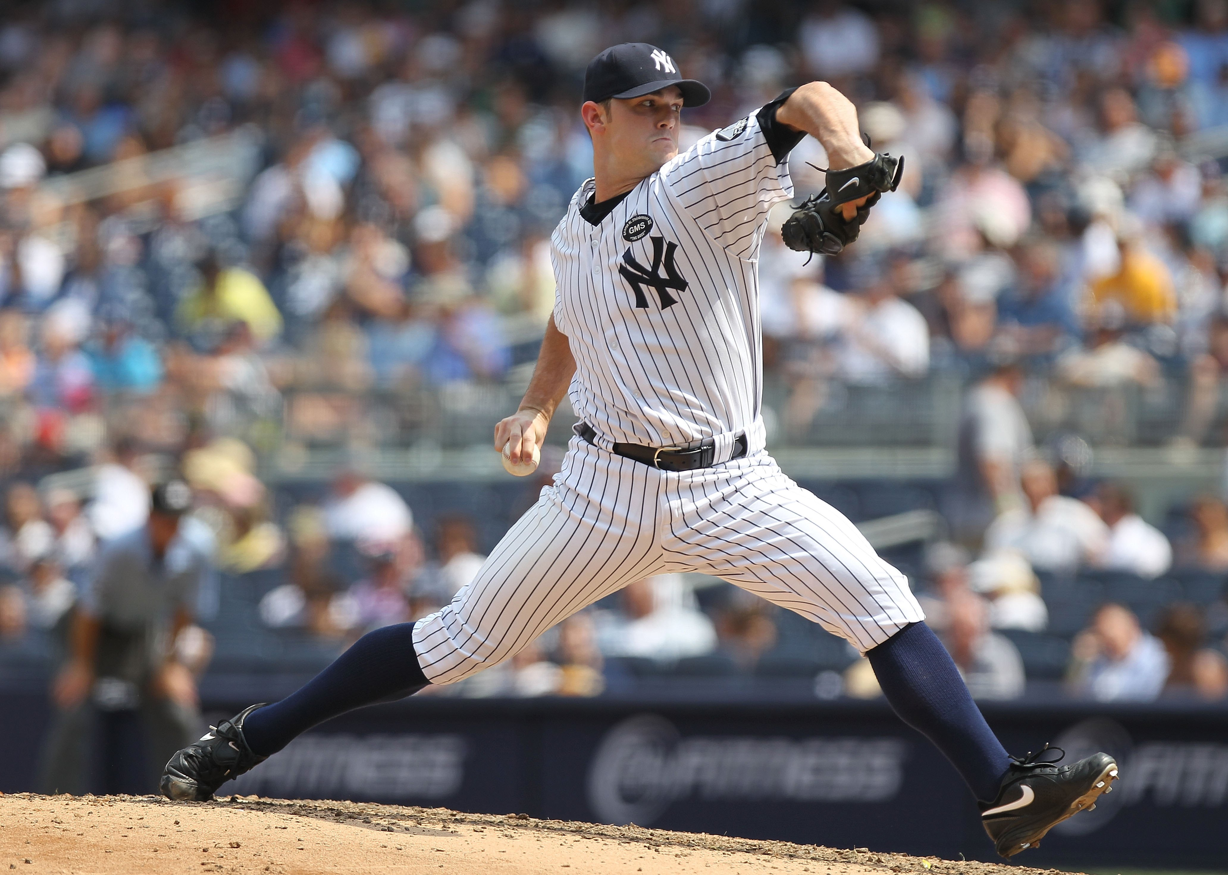 NEW YORK - JULY 21:  David Robertson #30 of the New York Yankees pitches against the Los Angeles Angels of Anaheim at Yankee Stadium on July 21, 2010 in the Bronx borough of New York City.  (Photo by Nick Laham/Getty Images)
