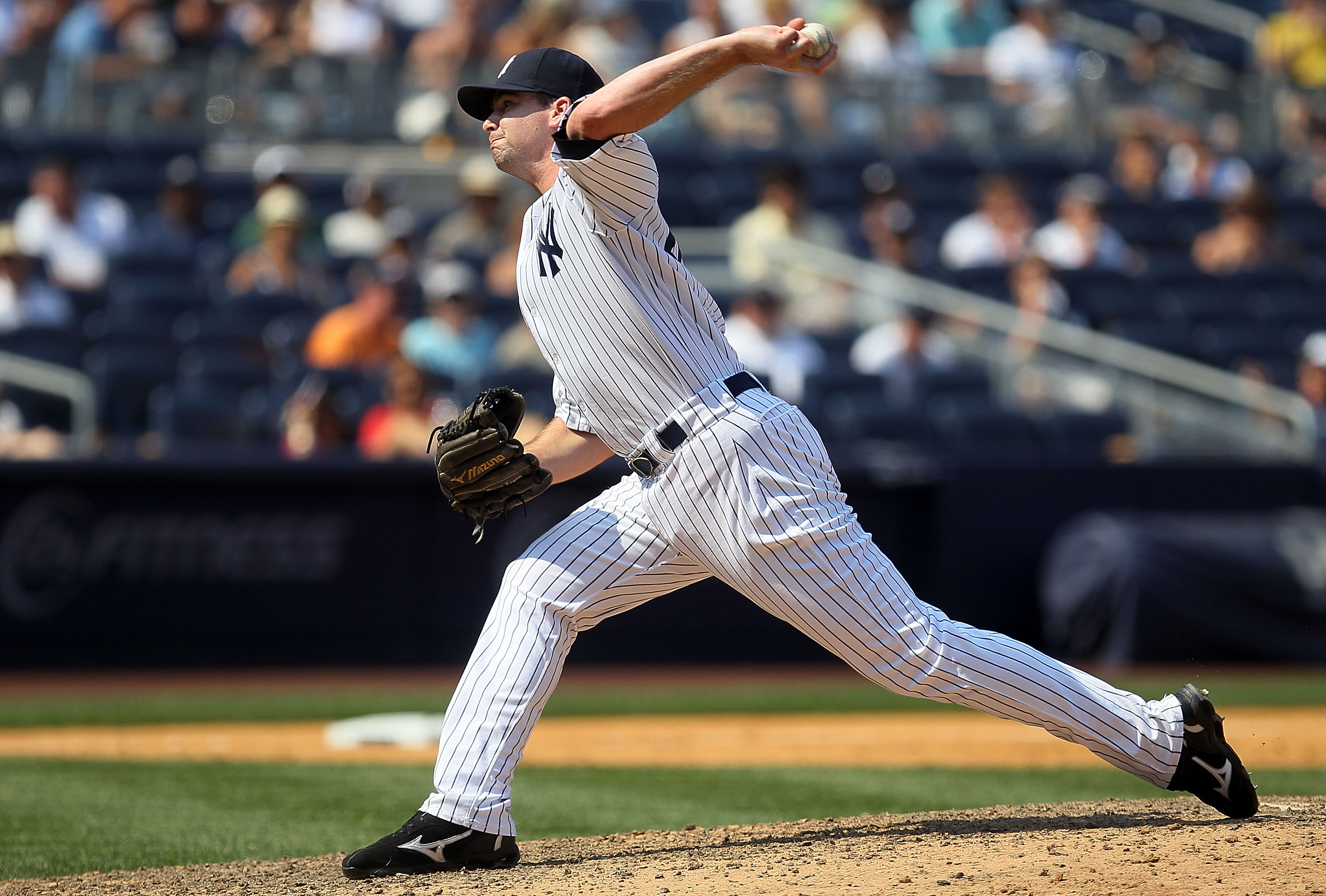 NEW YORK - JULY 18:  Boone Logan #48 of the New York Yankees delivers a pitch against the Tampa Bay Rays on July 18, 2010 at Yankee Stadium in the Bronx borough of New York City. The Yankees defeated the Rays 9-5.  (Photo by Jim McIsaac/Getty Images)
