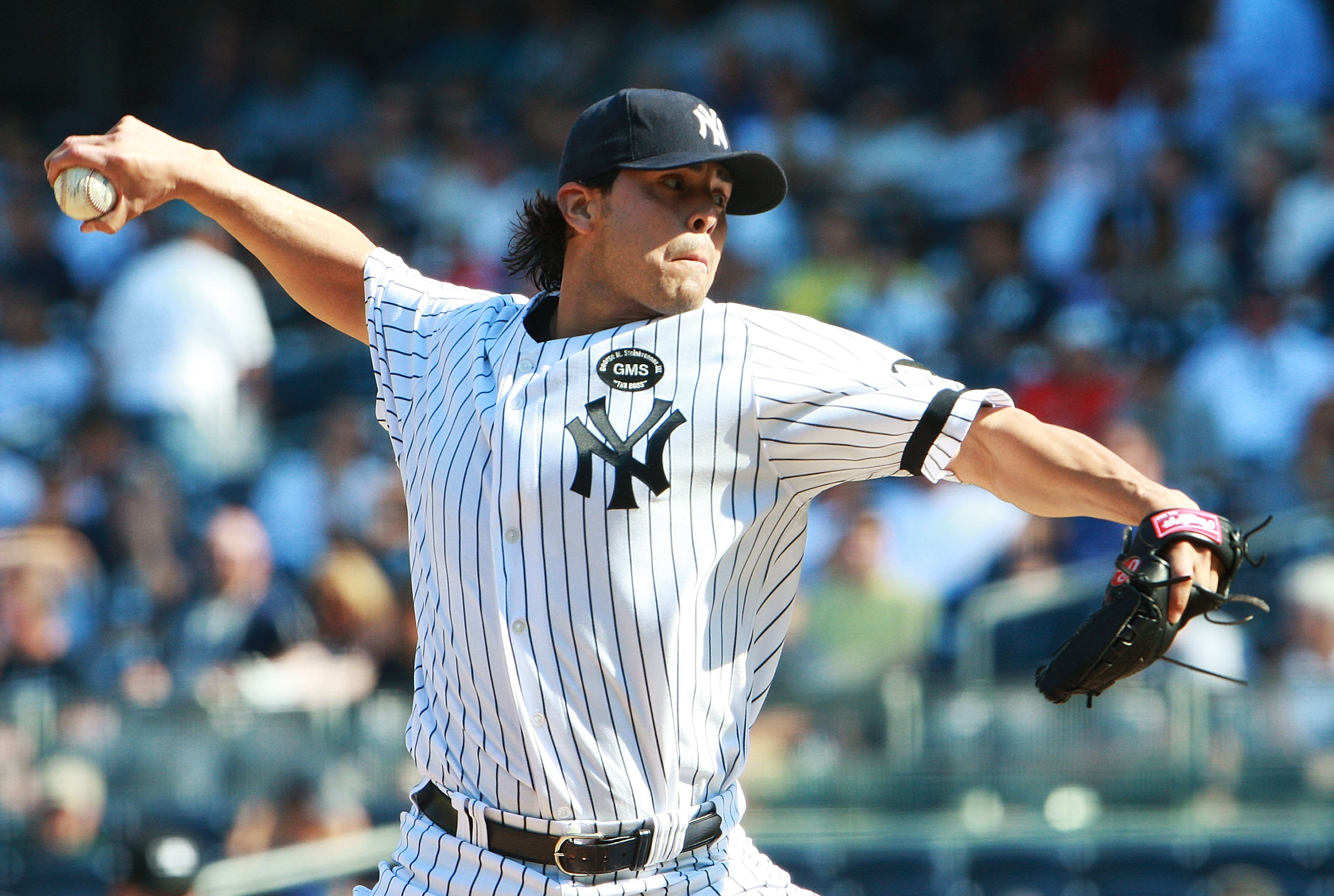 NEW YORK - AUGUST 19:  Sergio Mitre #45 the New York Yankees pitches against the Detroit Tigers at Yankee Stadium on August 19, 2010 in the Bronx borough of New York City.  (Photo by Andrew Burton/Getty Images)