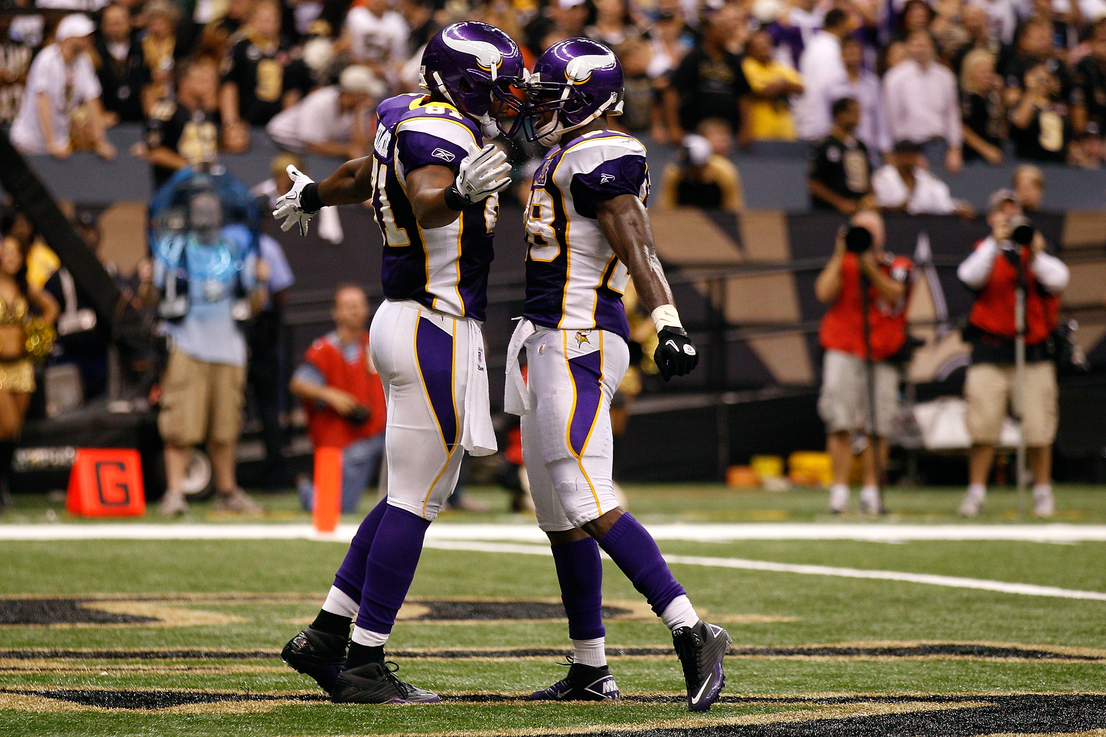 NEW ORLEANS - SEPTEMBER 09:  (L-R) Visanthe Shiancoe #81 and Adrian Peterson #28 of the Minnesota Vikings celebrate after Shiancoe scored a 20-yard touchdown reception in the second quarter against the New Orleans Saints at Louisiana Superdome on Septembe