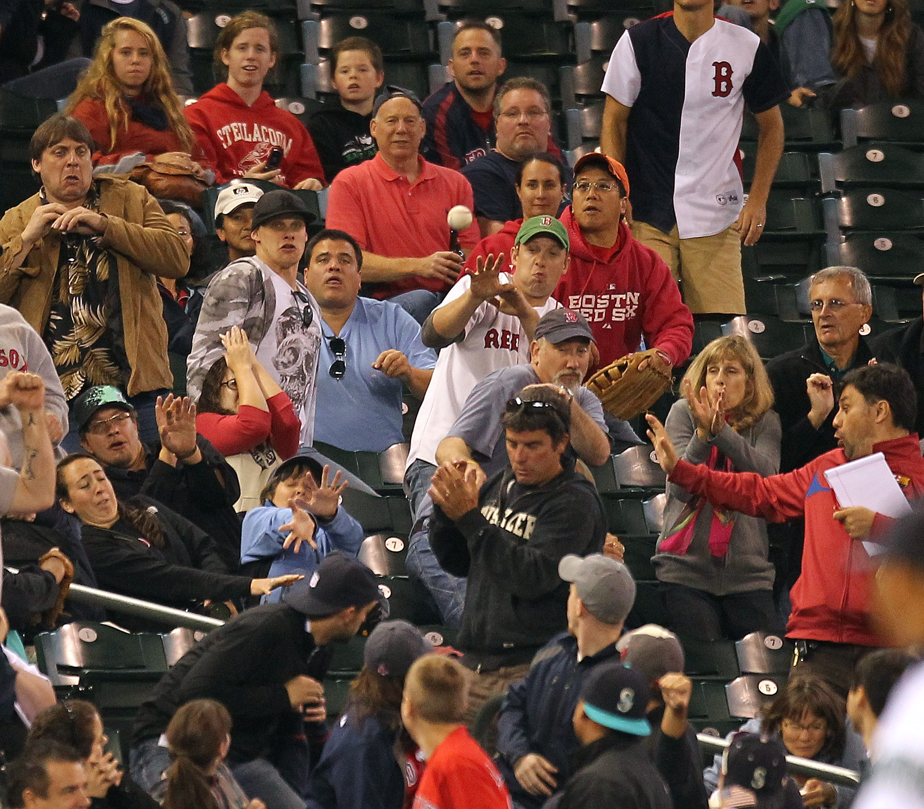 SEATTLE - SEPTEMBER 15:  Fans react to a foul ball by Marco Scutaro #16 of the Boston Red Sox during the game against the Seattle Mariners at Safeco Field on September 15, 2010 in Seattle, Washington. (Photo by Otto Greule Jr/Getty Images)