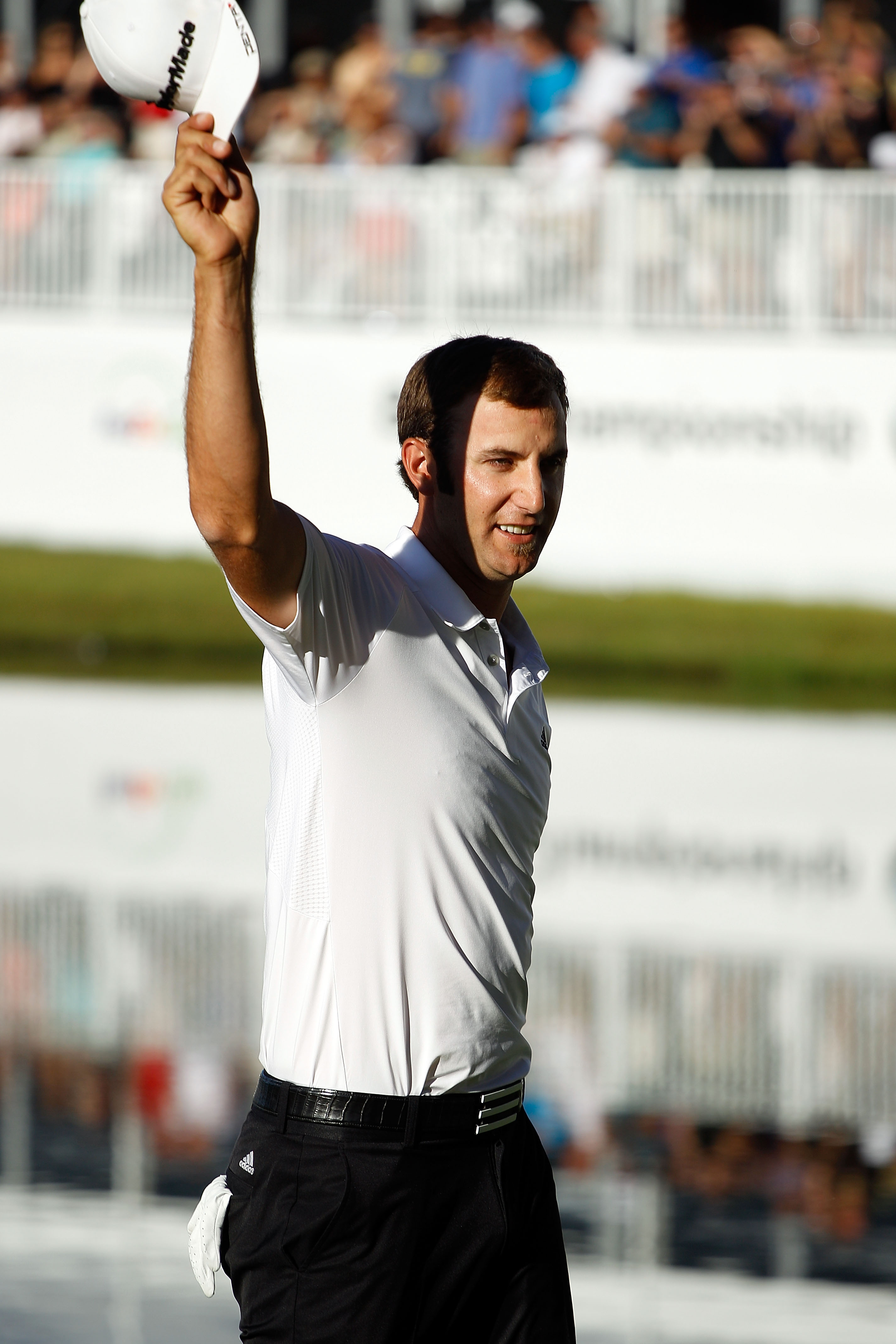 LEMONT, IL - SEPTEMBER 12:  Dustin Johnson reacts after making a putt on the 18th green to win the BMW Championship at Cog Hill Golf & Country Club on September 12, 2010 in Lemont, Illinois.  (Photo by Scott Halleran/Getty Images)