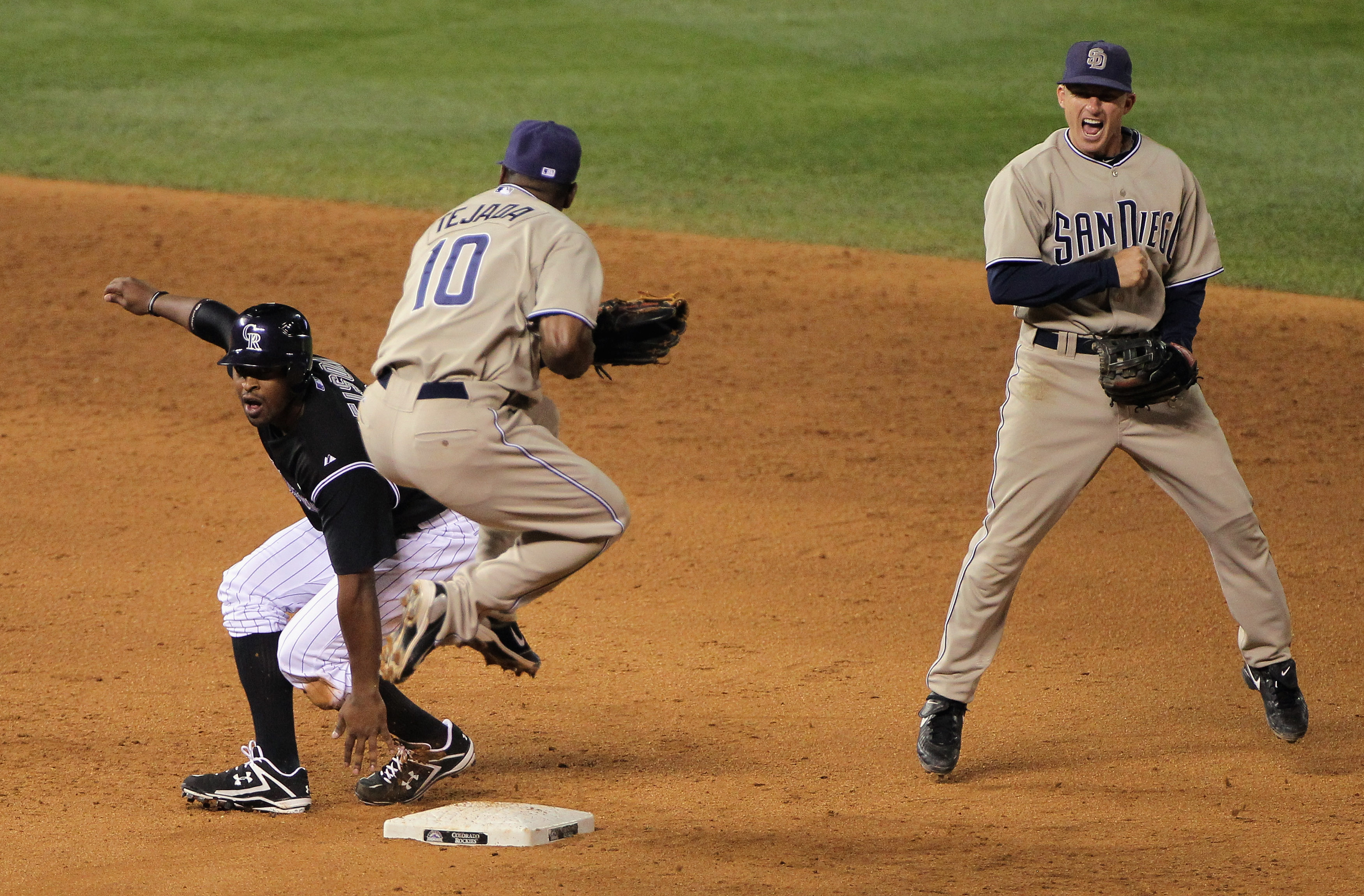 DENVER - SEPTEMBER 14:  Shortstop Miguel Tejada #10 and second baseman David Eckstein #22 of the San Diego Padres celebrate after Tejada turned a double play on Chris Nelson #10 of the Colorado Rockies on a ground ball hit to him by Eric Young Jr to end t