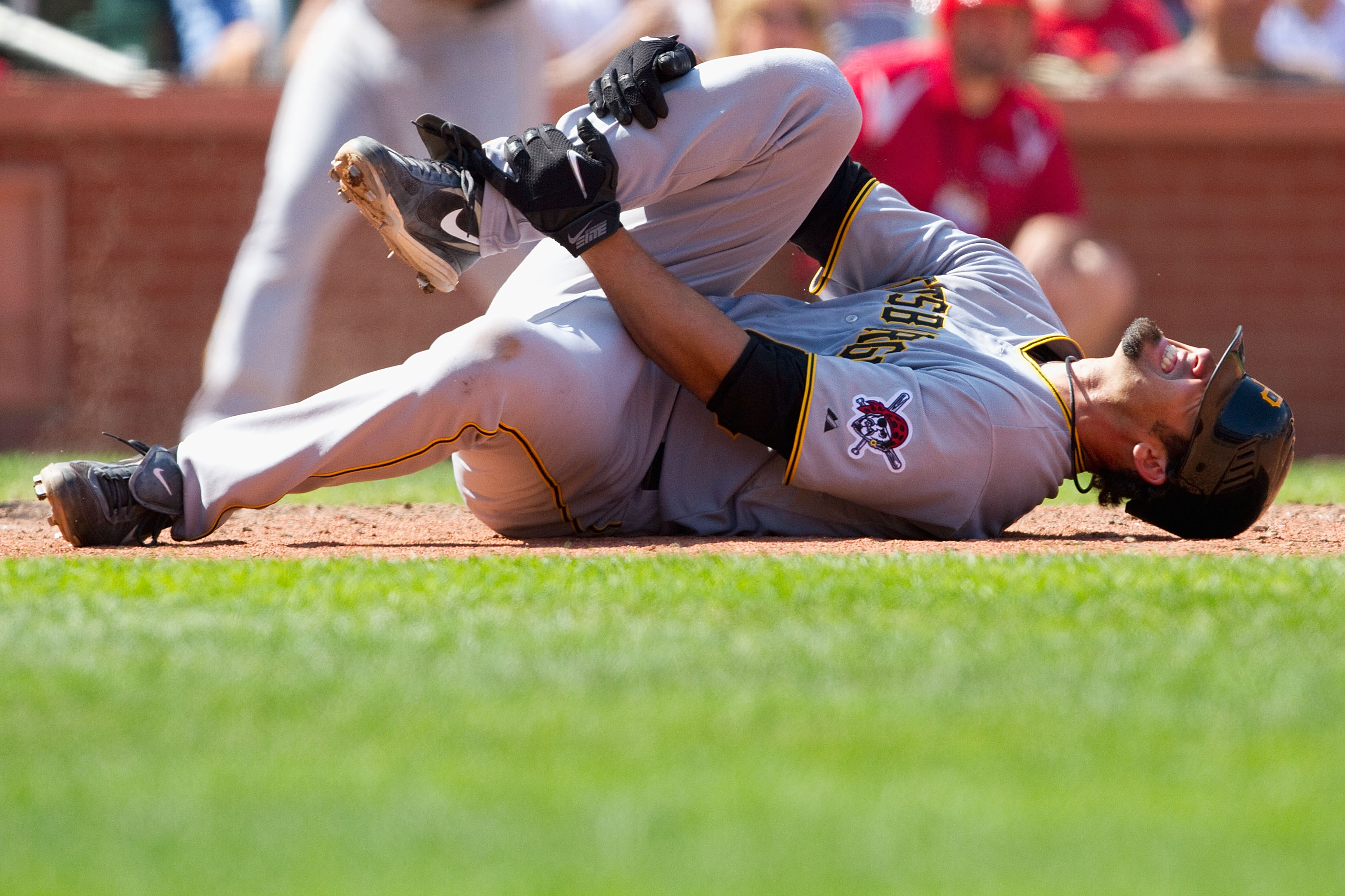 ST. LOUIS - AUGUST 1: Garrett Jones #46 of the Pittsburgh Pirates reacts to fouling a pitch off his leg against the St. Louis Cardinals at Busch Stadium on August 1, 2010 in St. Louis, Missouri.  The Cardinals beat the Pirates 9-1.  (Photo by Dilip Vishwa