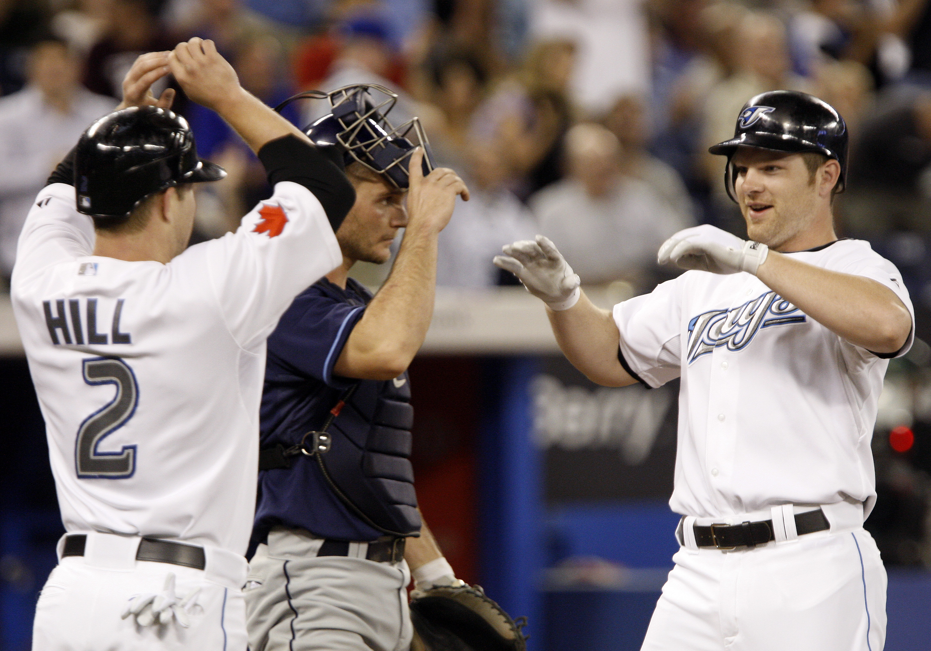 TORONTO - MAY 31: Adam Lind #26 and Aaron Hill #2 of the Toronto Blue Jays celebrate a two-run home run by Lind against the Tampa Bay Rays at the Rogers Centre during an MLB game May 31, 2010 in Toronto, Ontario, Canada. (Photo by Abelimages/Getty Images)