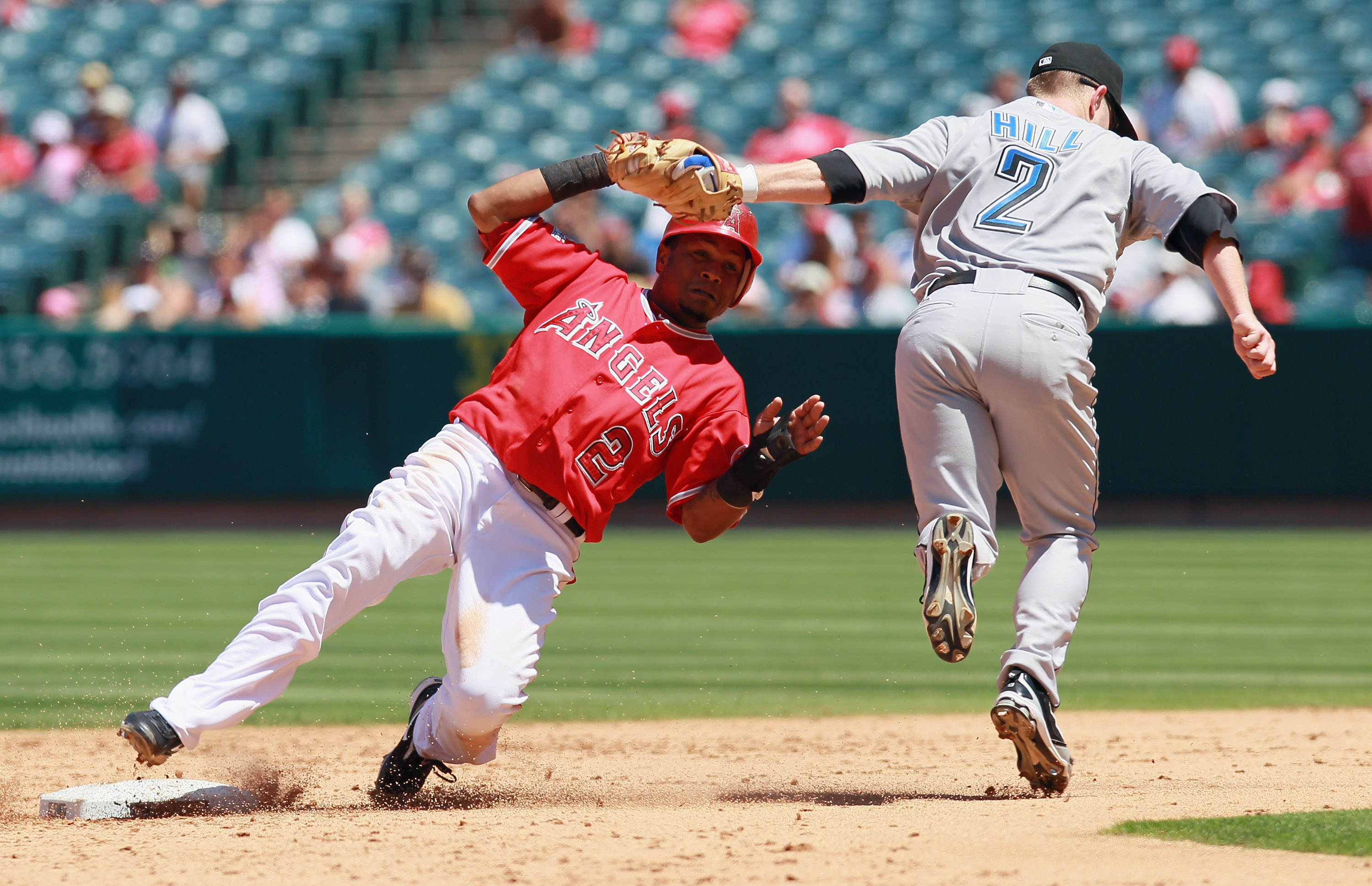 ANAHEIM, CA - AUGUST 15:  Erick Aybar #2 of the Los Angeles Angels of Anaheim is tagged out at second base by second baseman Aaron Hill #2 of the Toronto Blue Jays on a steal attempt in the fifth inning at Angel Stadium on August 15, 2010 in Anaheim, Cali