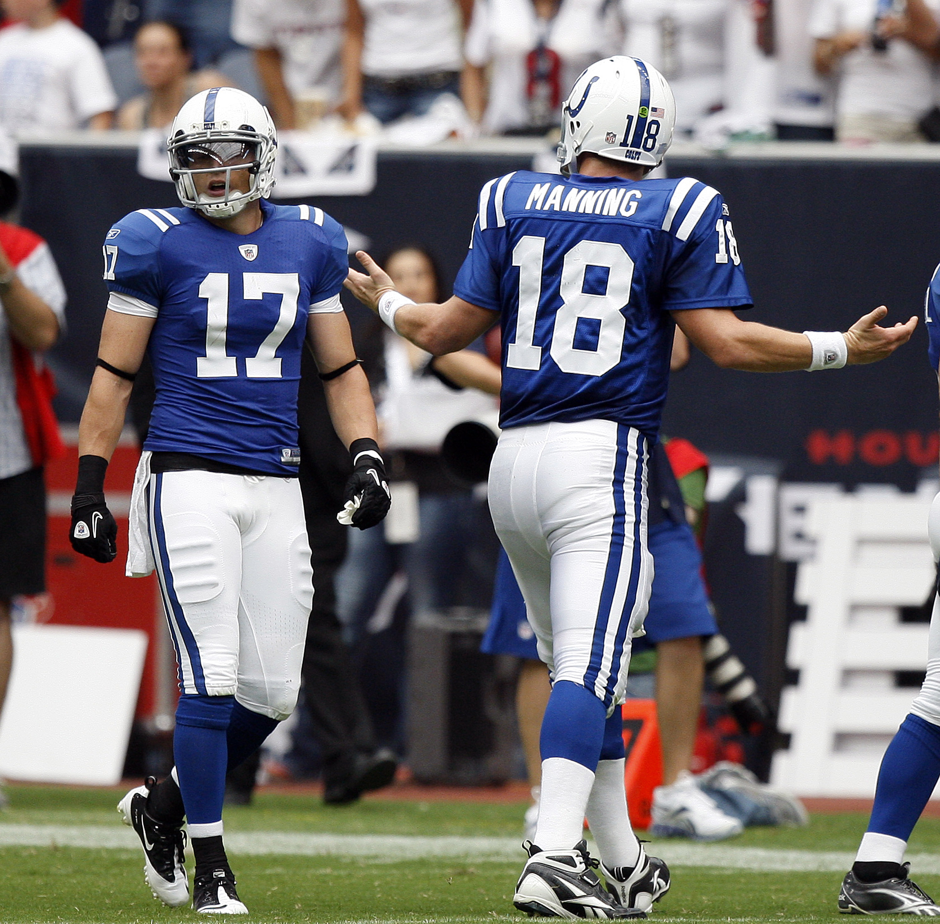 HOUSTON - SEPTEMBER 12:  Quarterback Peyton Manning #18 of the Indianapolis Colts gestures to wide receiver Austion Collie #17 after a change of possession against the Houston Texans during the NFL season opener at Reliant Stadium on September 12, 2010 in