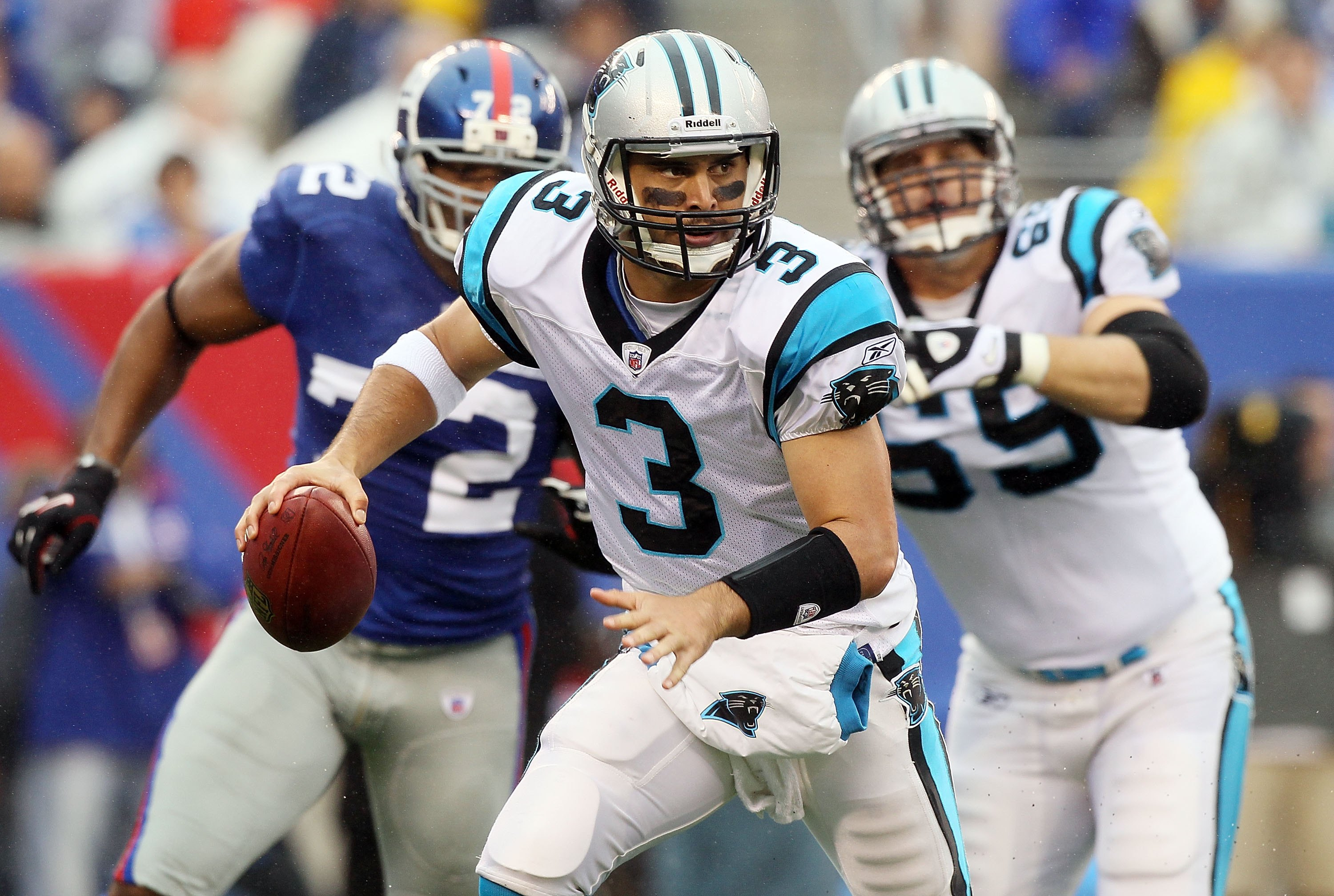 EAST RUTHERFORD, NJ - SEPTEMBER 12:  Matt Moore #3 of the Carolina Panthers scrambles against the New York Giants on September 12, 2010 at the New Meadowlands Stadium in East Rutherford, New Jersey.  (Photo by Jim McIsaac/Getty Images)