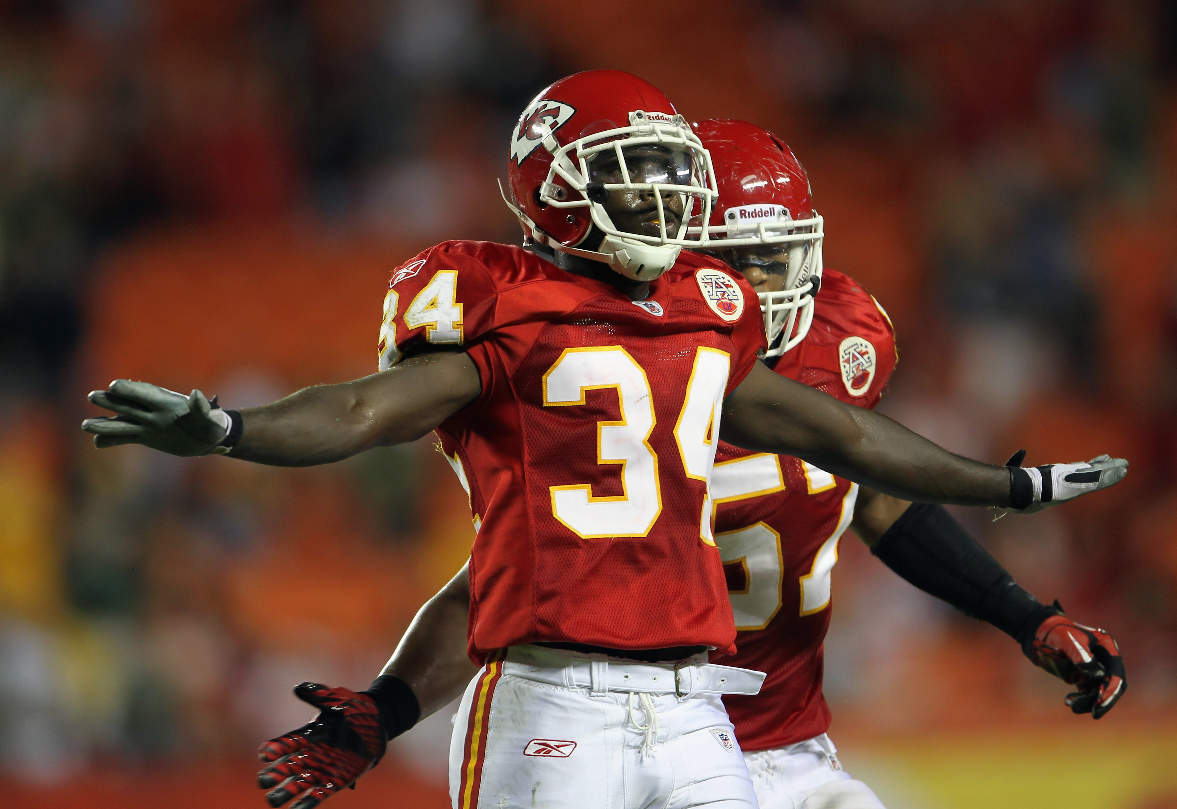 KANSAS CITY, MO - SEPTEMBER 02:  Travis Daniels #34 and Justin Cole #57 of the Kansas City Chiefs celebrates after stopping a final drive during the game against the Green Bay Packers on September 2, 2010 at Arrowhead Stadium in Kansas City, Missouri.  (P
