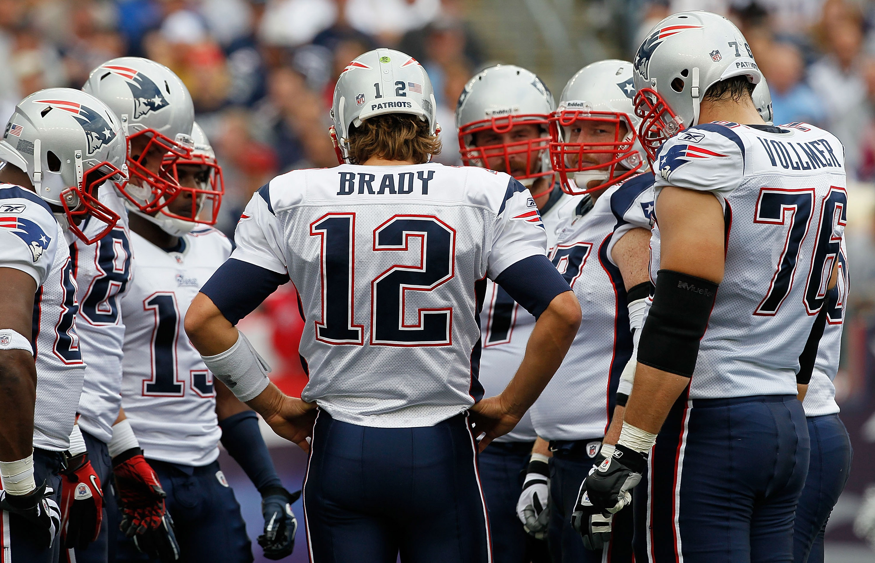 FOXBORO, MA - SEPTEMBER 12: Quarterback Tom Brady #12  of the New England Patriots hurdles with the offense during the NFL season opener against the Cincinnati Bengals at Gillette Stadium on September 12, 2010 in Foxboro, Massachusetts. (Photo by Jim Roga