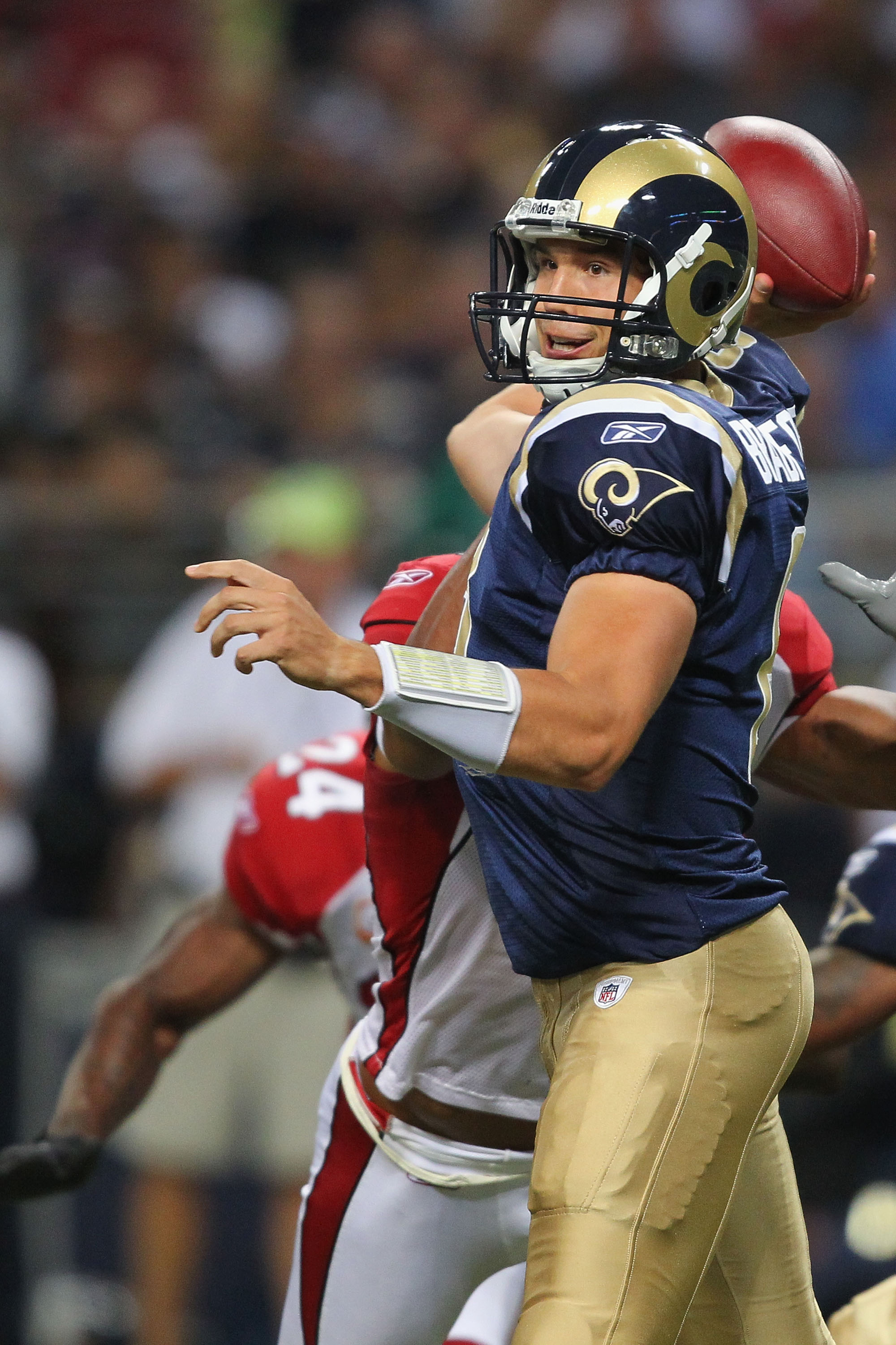 ST. LOUIS - SEPTEMBER 12: Sam Bradford #8 of the St. Louis Rams passes against the Arizona Cardinals during the NFL season opener at the Edward Jones Dome on September 12, 2010 in St. Louis, Missouri.  The Cardinals beat the Rams 17-13.  (Photo by Dilip V