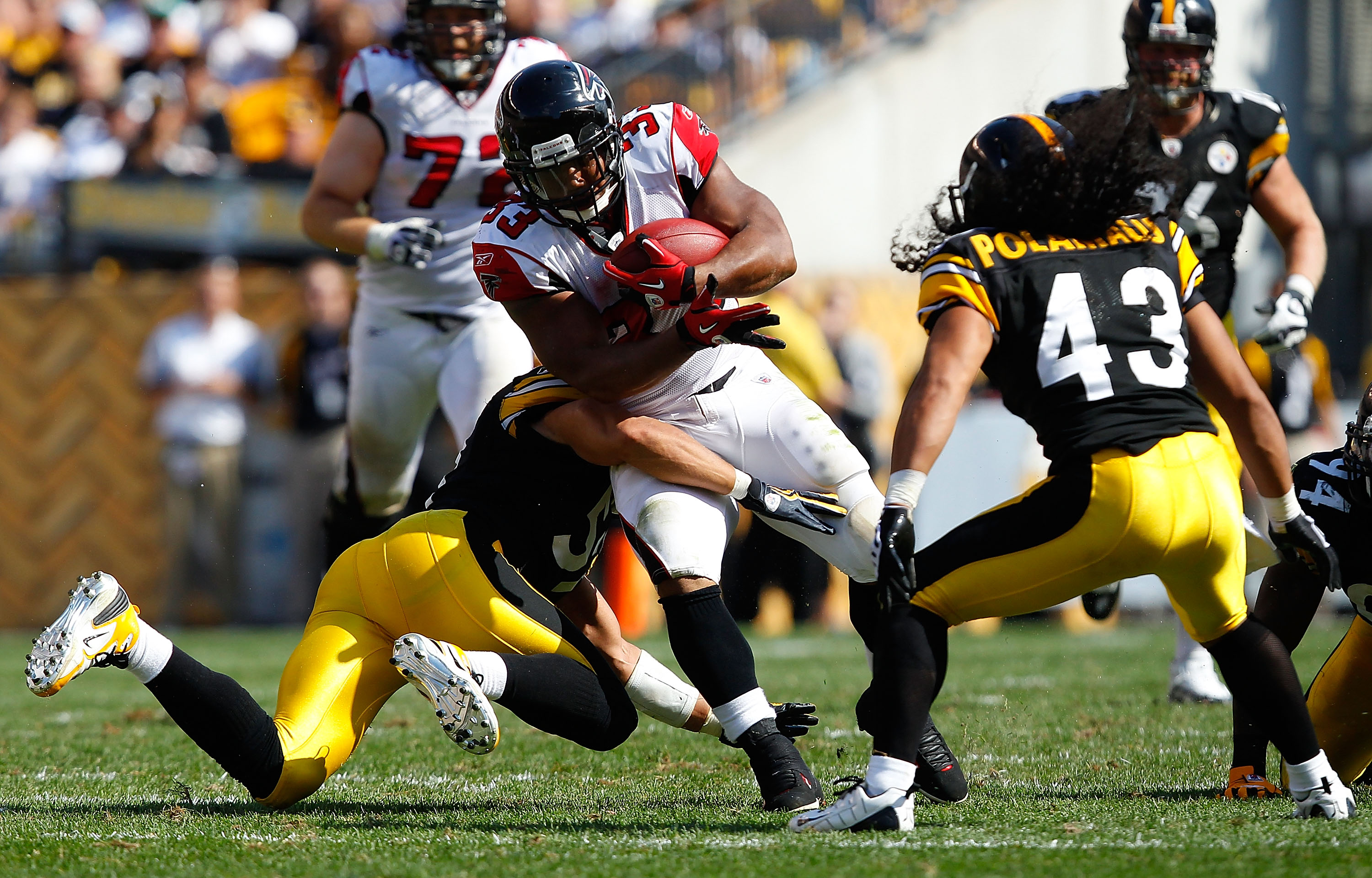 PITTSBURGH - SEPTEMBER 12:  Michael Turner #33 of the Atlanta Falcons attempts to run through a tackle by James Farrior #51 of the Pittsburgh Steelers during the NFL season opener game on September 12, 2010 at Heinz Field in Pittsburgh, Pennsylvania.  (Ph