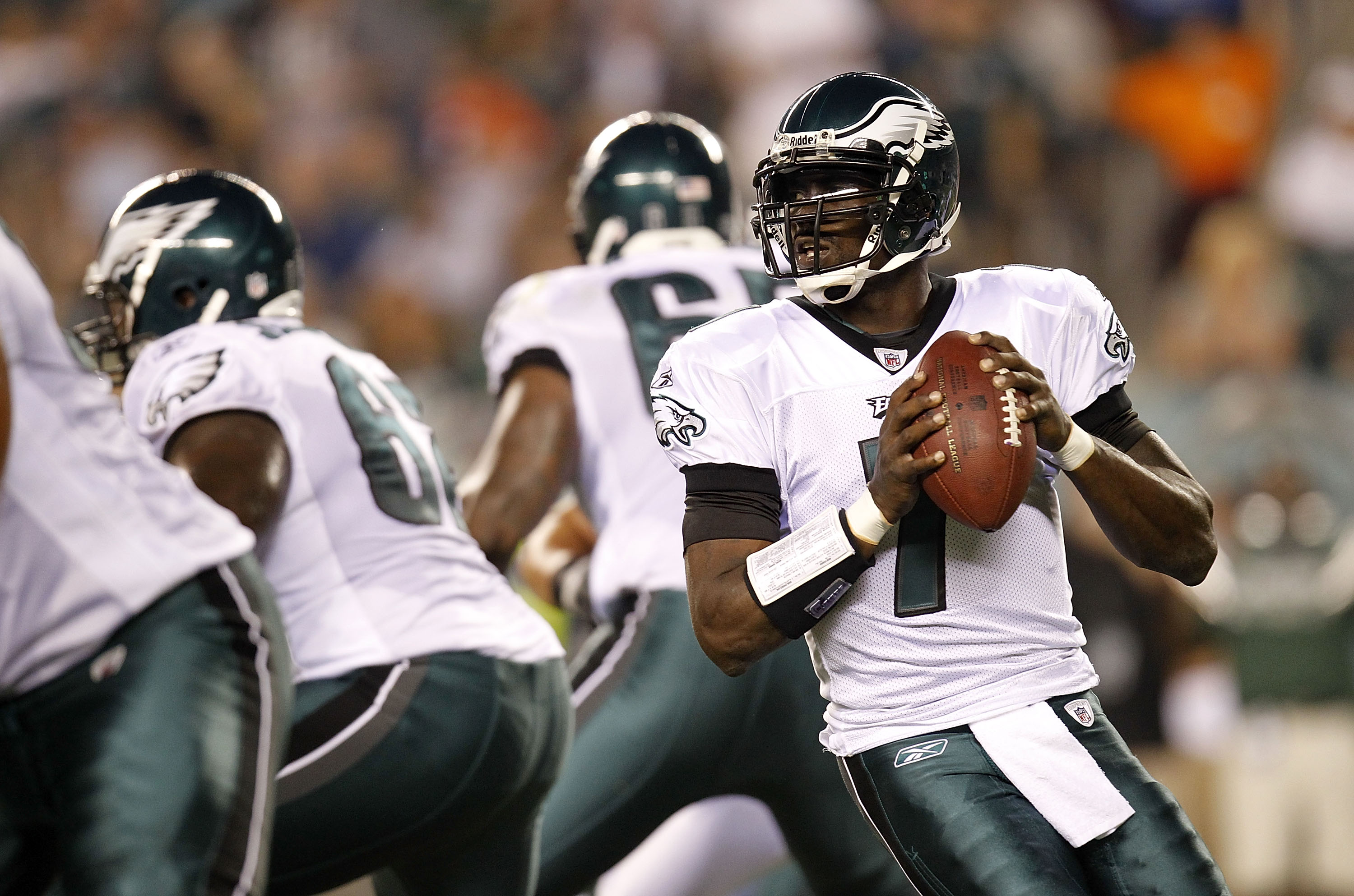 PHILADELPHIA - SEPTEMBER 02:  Michael Vick #7 of the Philadelphia Eagles drops back to pass during a preseason game against the New York Jets at Lincoln Financial Field on September 2, 2010 in Philadelphia, Pennsylvania.  (Photo by Jeff Zelevansky/Getty I