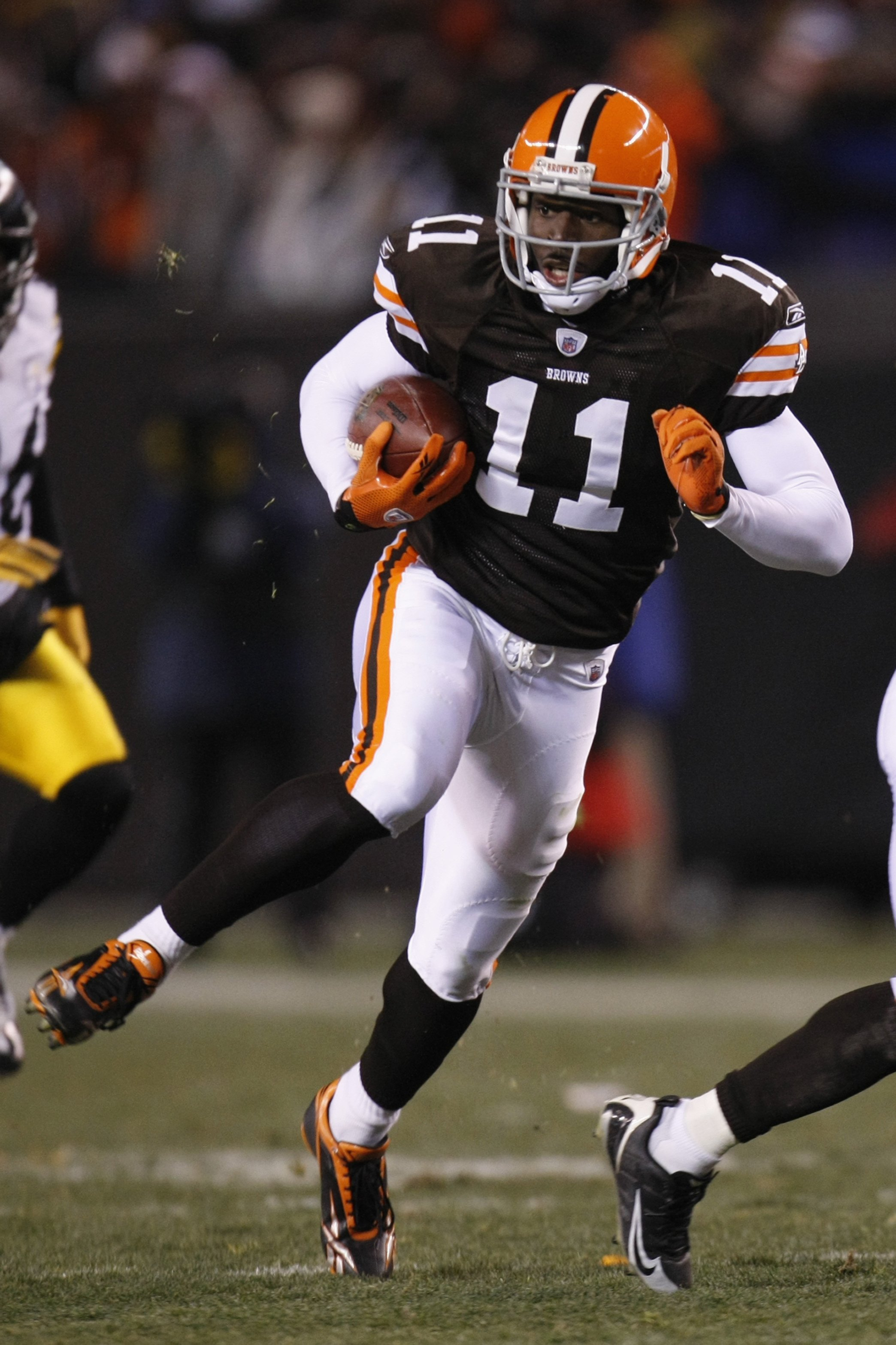 CLEVELAND - DECEMBER 10:  Mohamed Massaquoi #11 of the Cleveland Browns runs with the ball during the game against the Pittsburgh Steelers on December 10, 2009 at Cleveland Browns Stadium in Cleveland, Ohio. Cleveland won the game 13-6.  (Photo by Gregory