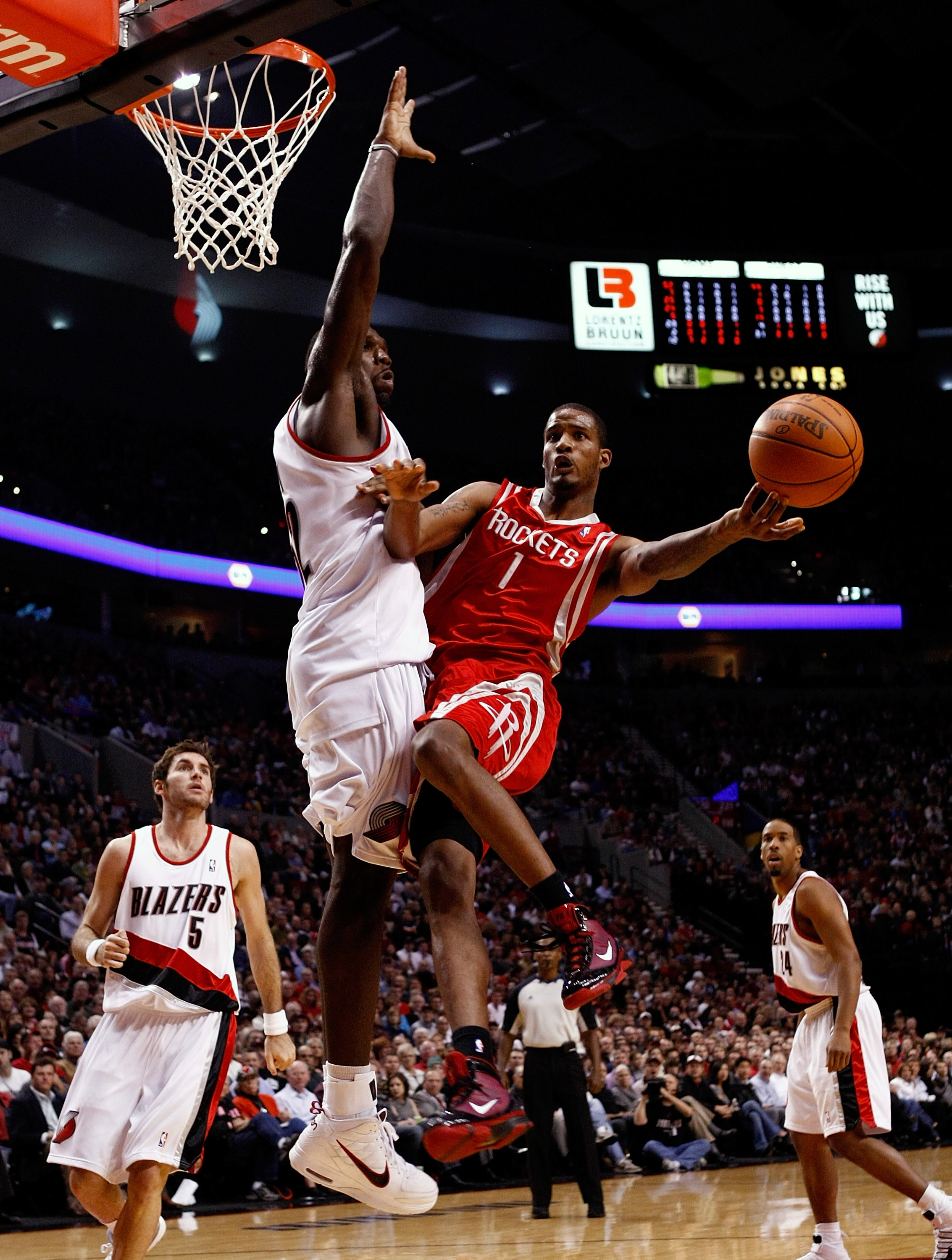 PORTLAND, OR - OCTOBER 27:  Trevor Ariza #1 of the Houston Rockets is guarded by Greg Oden #52 of the Portland Trail Blazers during the season opener on October 27, 2009 at the Rose Garden in Portland, Oregon. NOTE TO USER: User expressly acknowledges and