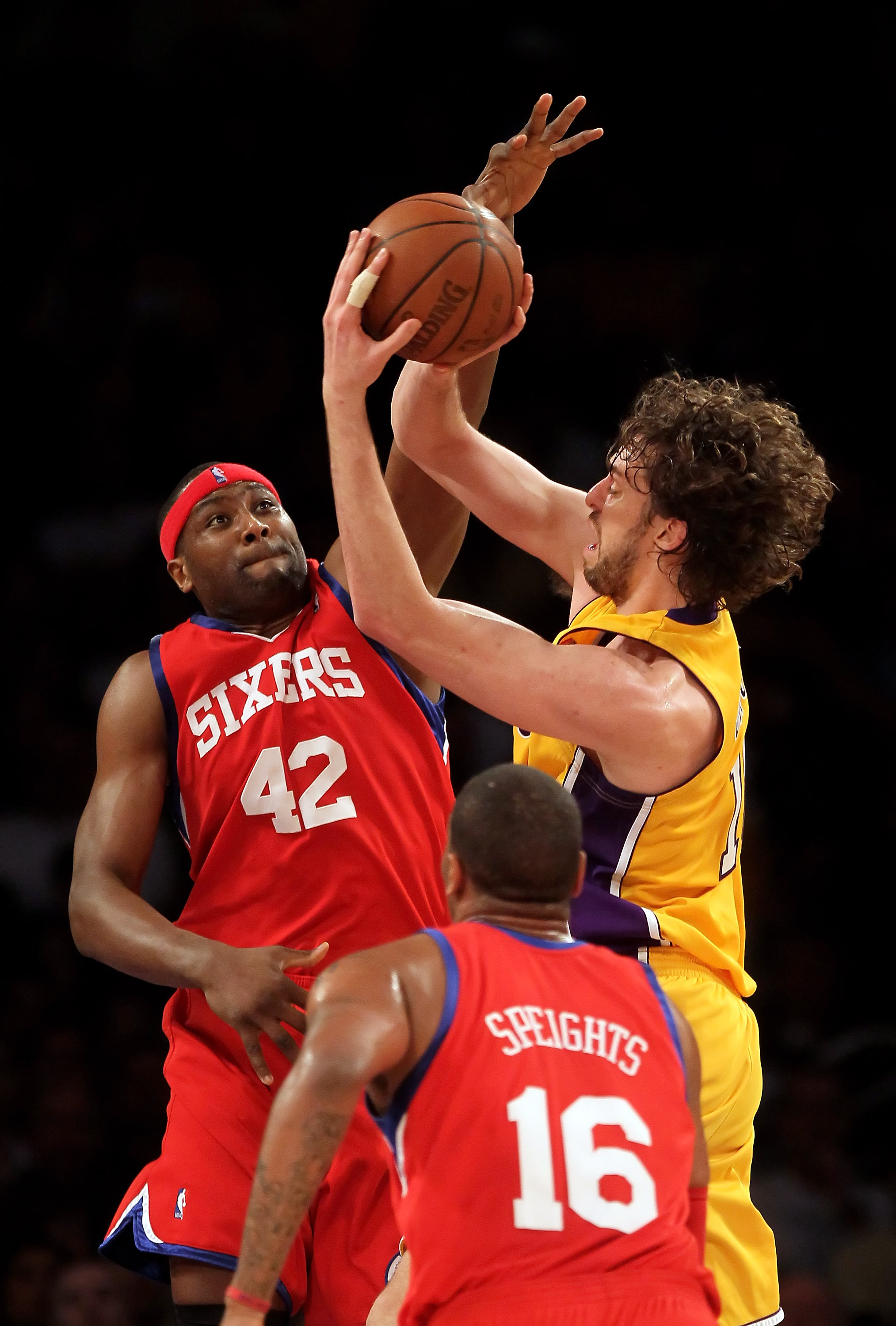 LOS ANGELES, CA - FEBRUARY 26:  Pau Gasol #16 of the Los Angeles Lakers is defended by Elton Brand #42 of the Philadelphia 76ers in the first half at Staples Center on February 26, 2010 in Los Angeles, California. NOTE TO USER: User expressly acknowledges