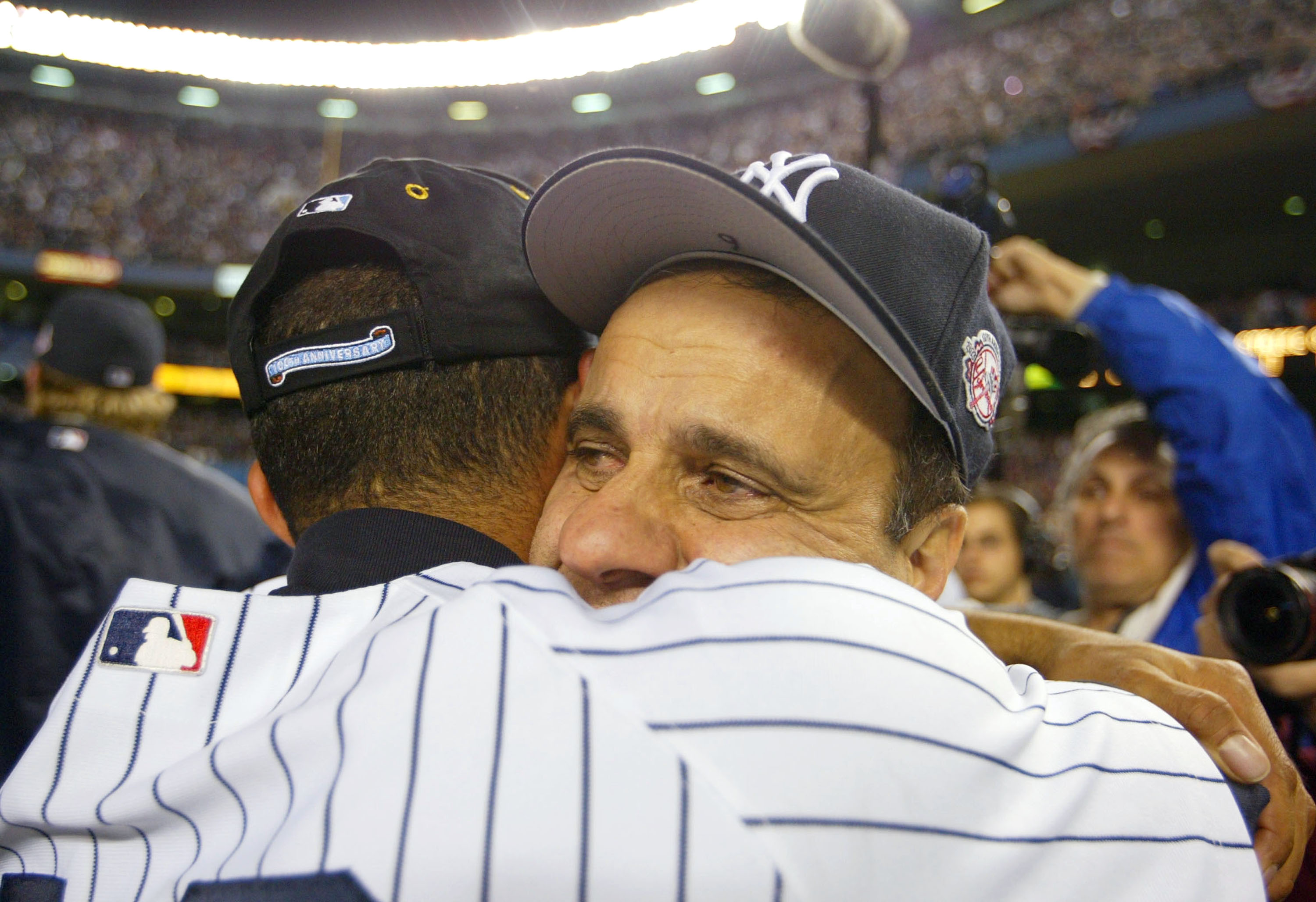 BRONX, NY - OCTOBER 16:  Manager Joe Torre hugs Mariano Rivera #42 of the New York Yankees after defeating the Boston Red Sox 6-5 in game 7 of the American League Championship Series on October 16, 2003 at Yankee Stadium in the Bronx, New York.  The Yanke