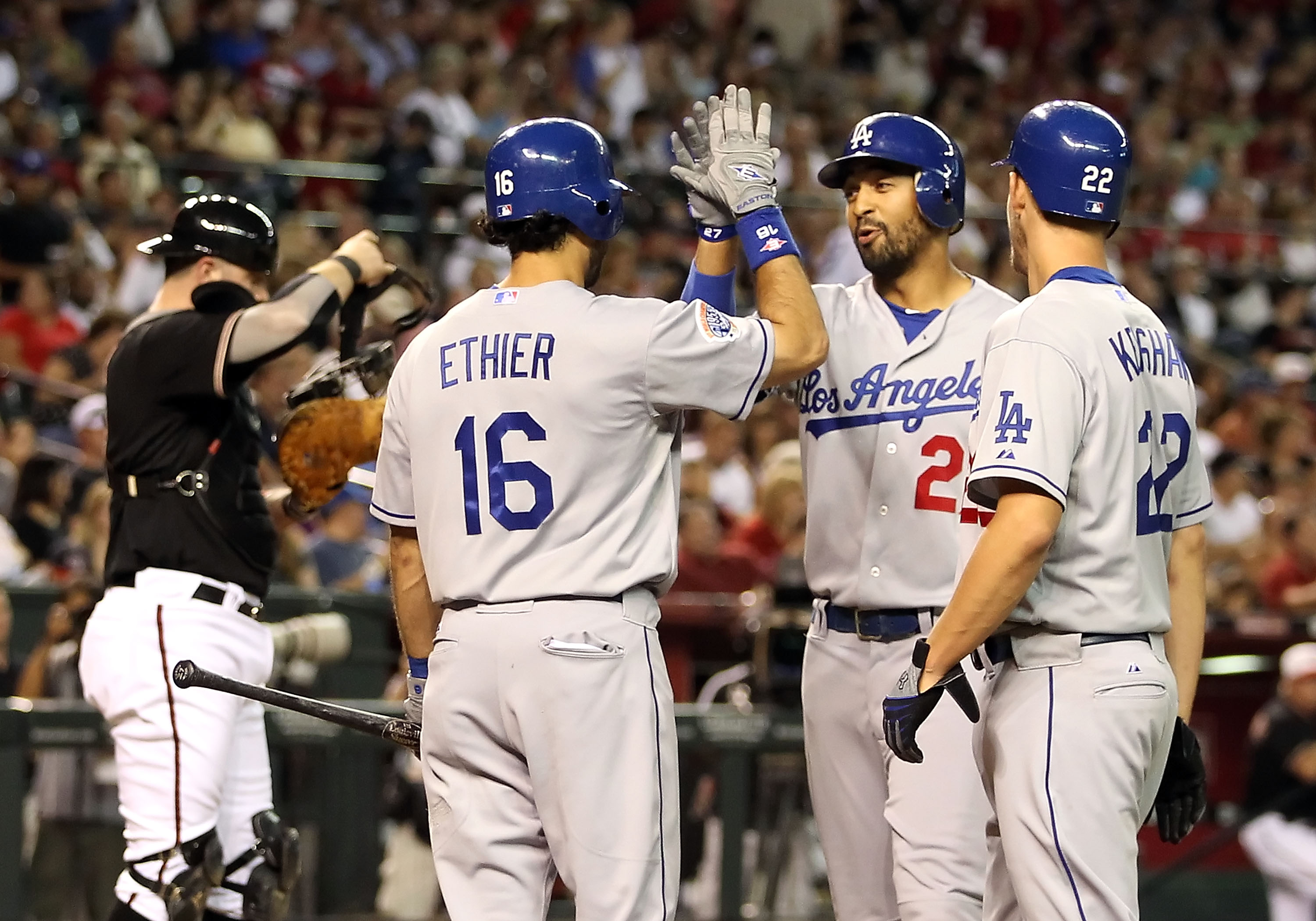 PHOENIX - JULY 03:  Matt Kemp #27 of the Los Angeles Dodgers is congratulated by teammates Andre Ethier #16 and Clayton Kershaw #22 after hitting a 2 run home run against the Arizona Diamondbacks during the second inning of the Major League Baseball game