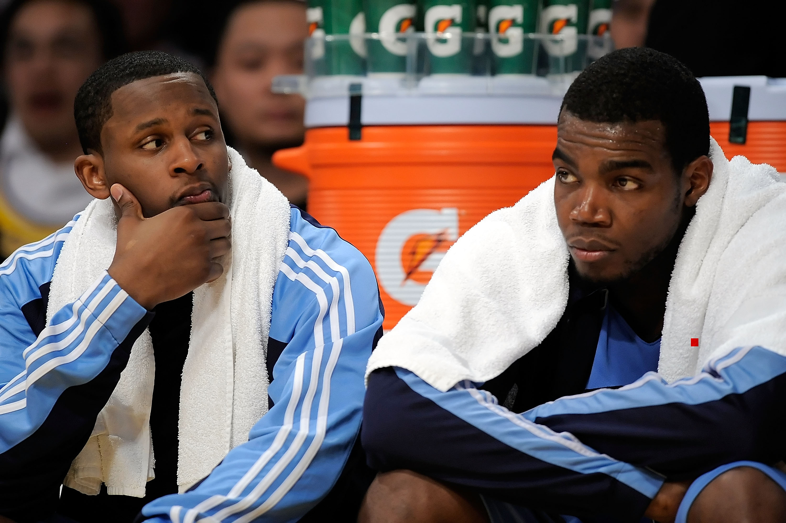 LOS ANGELES, CA - APRIL 27:  (L-R) C.J. Miles #34 and Paul Millsap #24 of the Utah Jazz sit on the bench in the second quarter against the Los Angeles Lakers in Game Five of the Western Conference Quarterfinals during the 2009 NBA Playoffs at Staples Cent