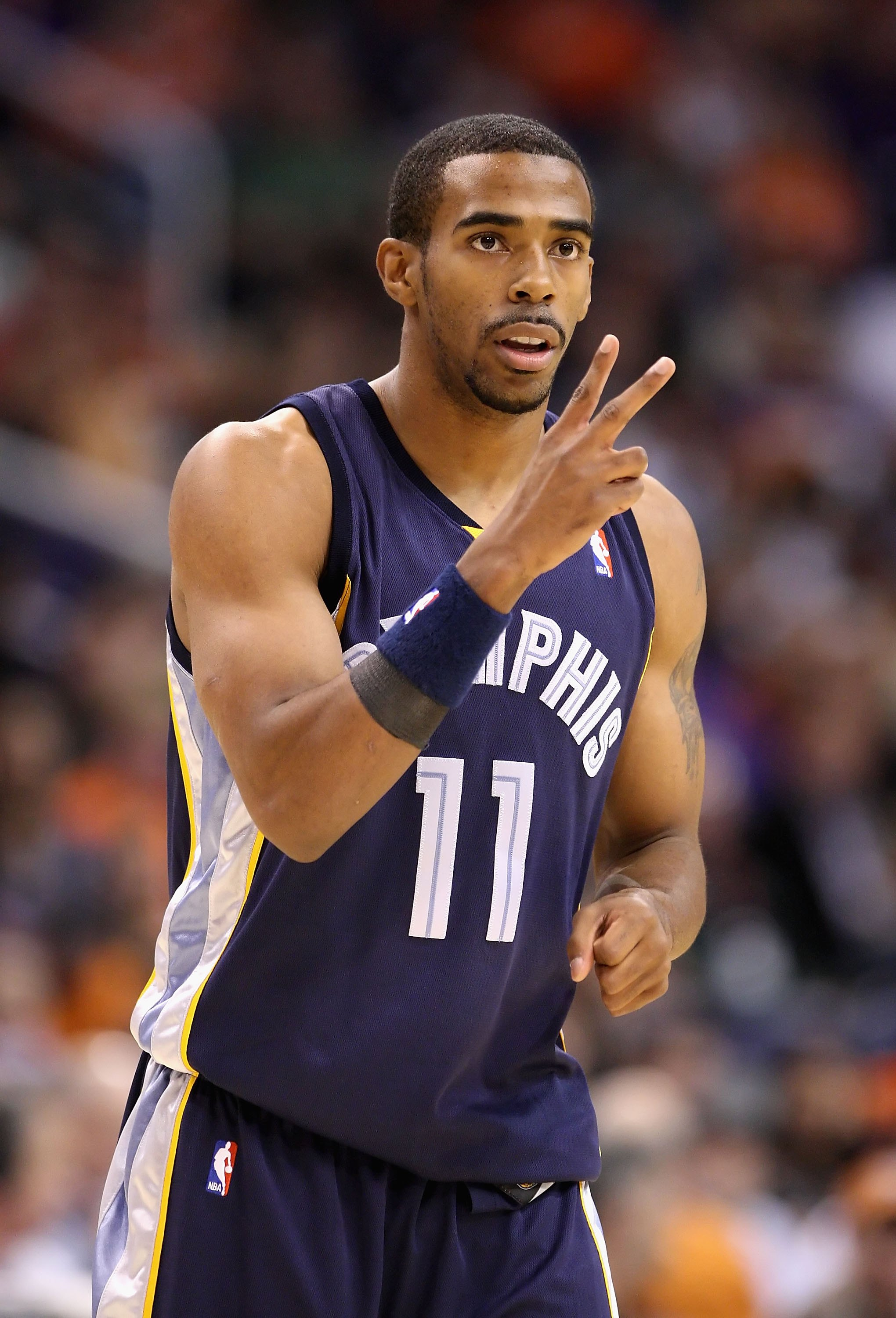 PHOENIX - NOVEMBER 25:  Mike Conley #11 of the Memphis Grizzlies during the NBA game against the Phoenix Suns at US Airways Center on November 25, 2009 in Phoenix, Arizona.  The Suns defeated the Grizzlies 126-111.  NOTE TO USER: User expressly acknowledg