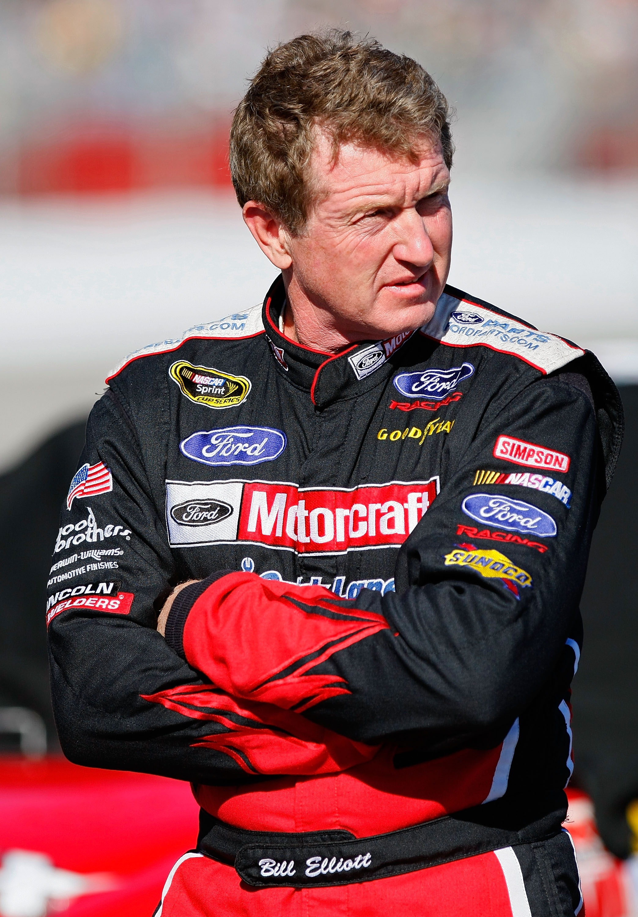 HAMPTON, GA - SEPTEMBER 04: Bill Elliott, driver of the #21 FordParts.com Ford, stands on the grid during qualifying for the NASCAR Sprint Cup Series Emory Healthcare 500 at Atlanta Motor Speedway on September 4, 2010 in Hampton, Georgia.  (Photo by Geoff