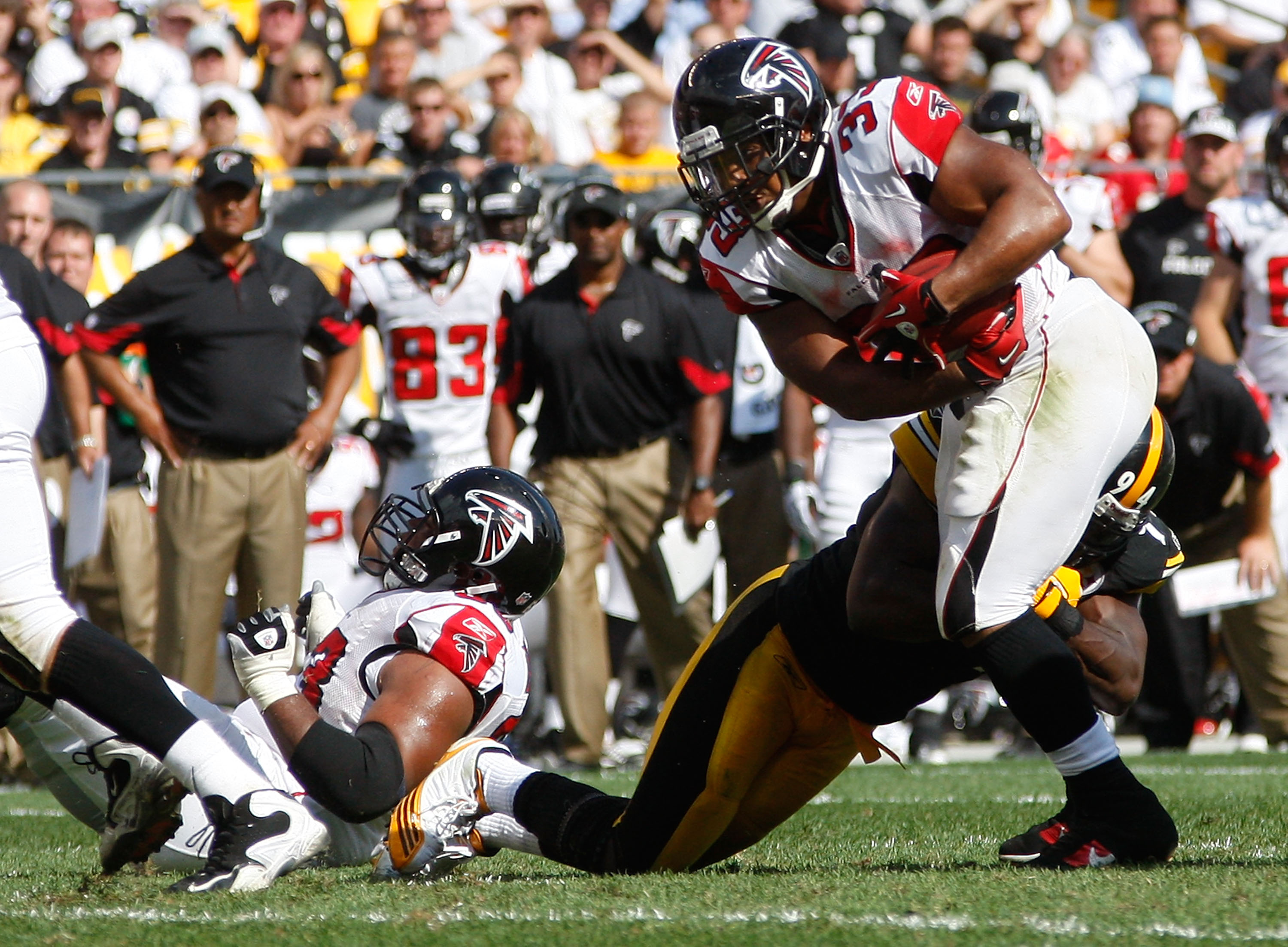 PITTSBURGH - SEPTEMBER 12:  Michael Turner #33 of the Atlanta Falcons attempts to run through Lawrence Timmons #94 of the Pittsburgh Steelers during the NFL season opener game on September 12, 2010 at Heinz Field in Pittsburgh, Pennsylvania.  (Photo by Ja