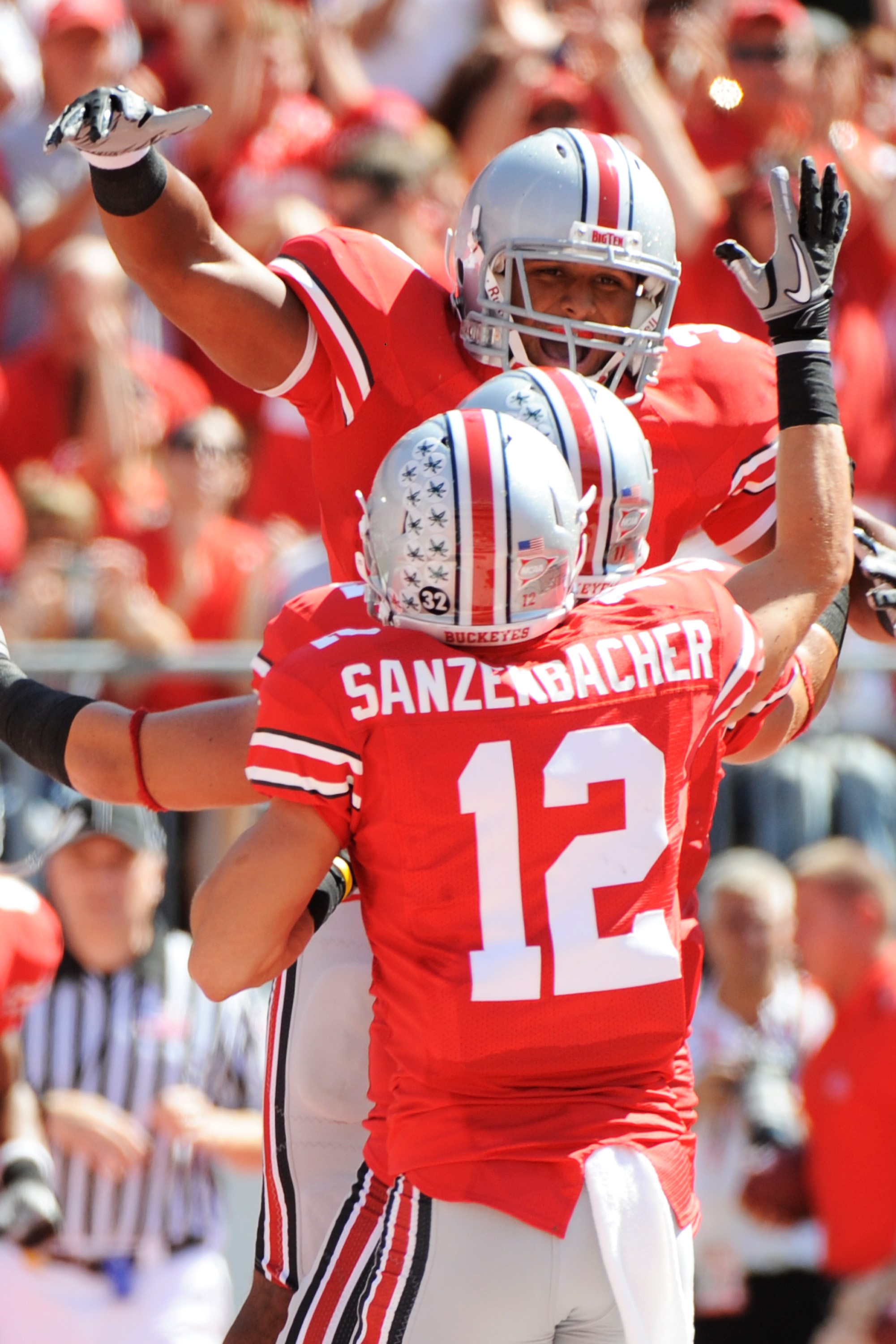 COLUMBUS, OH - SEPTEMBER 18:  Brandon Saine #3 of the Ohio State Buckeyes celebrates his first quarter touchdown against the Ohio Bobcats with Dane Sanzenbacher #12 of the Ohio State Buckeyes at Ohio Stadium on September 18, 2010 in Columbus, Ohio.  (Phot