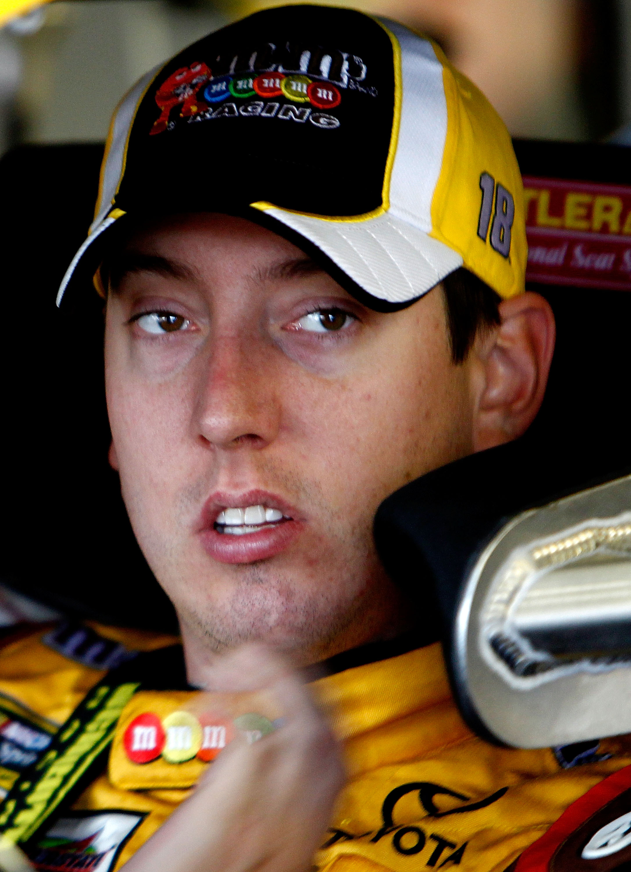LOUDON, NH - SEPTEMBER 17:  Kyle Busch, driver of the #18 M&M's Toyota, looks on during practice for the NASCAR Sprint Cup Series Sylvania 300 at New Hampshire Motor Speedway on September 17, 2010 in Loudon, New Hampshire.  (Photo by Jeff Zelevansky/Getty