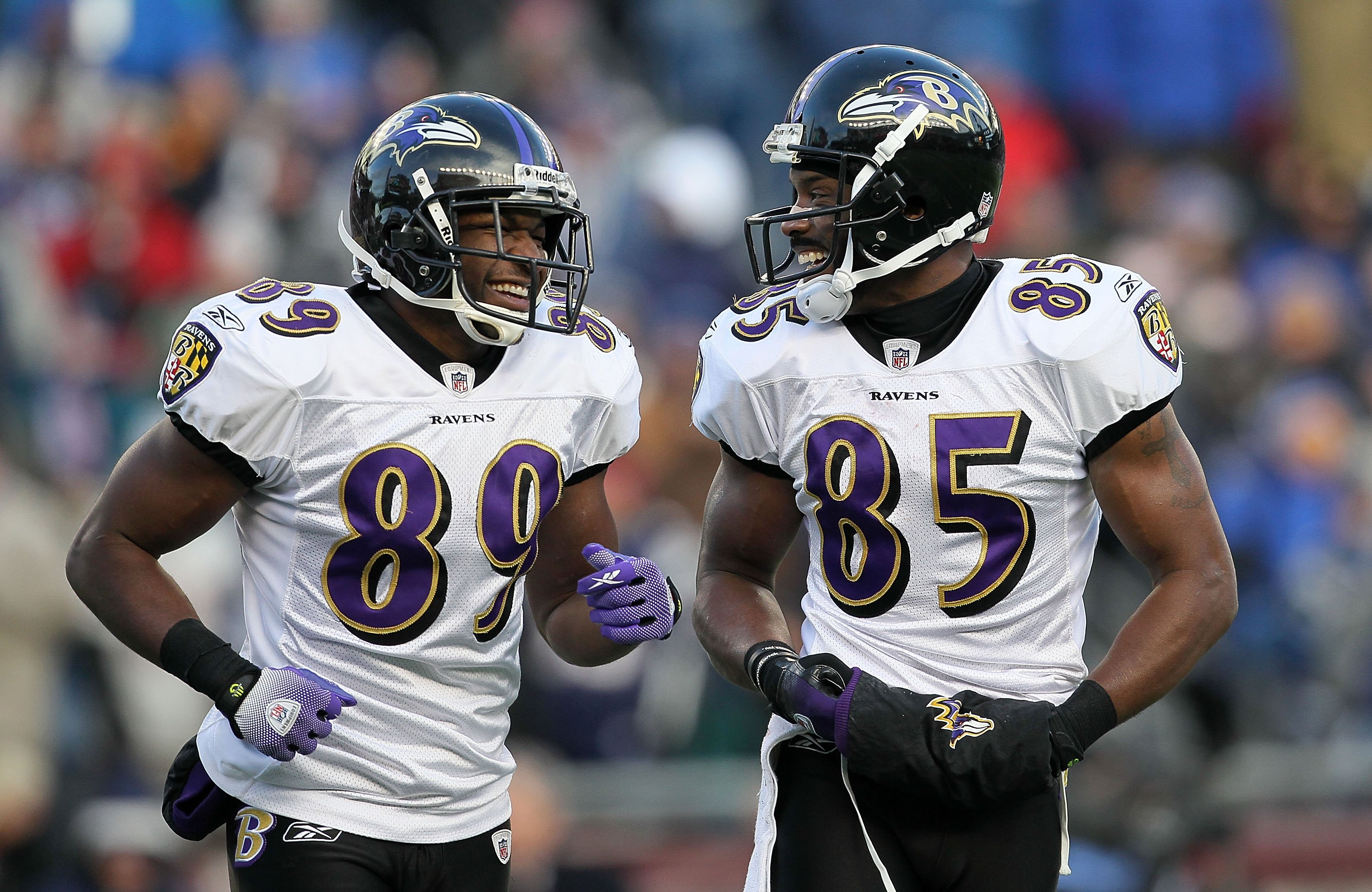 FOXBORO, MA - JANUARY 10:  (L-R) Mark Clayton #89 and Derrick Mason #85 of the Baltimore Ravens talk on the field against the New England Patriots during the 2010 AFC wild-card playoff game at Gillette Stadium on January 10, 2010 in Foxboro, Massachusetts