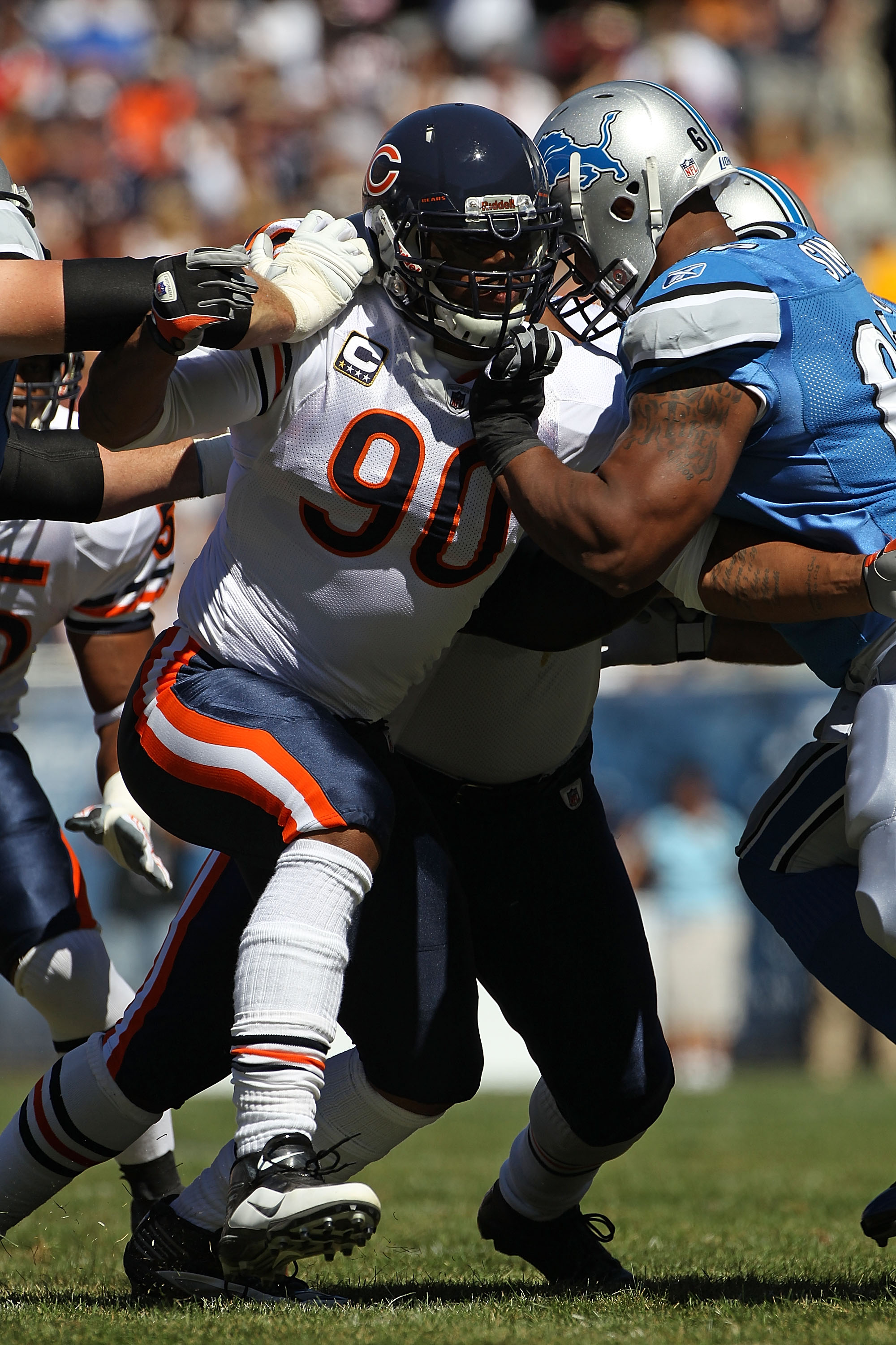 CHICAGO - SEPTEMBER 12: Julius Peppers #90 of the Chicago Bears rushes against Rob Sims #67 of the Detroit Lions during the NFL season opening game at Soldier Field on September 12, 2010 in Chicago, Illinois. The Bears defeated the Lions 19-14. (Photo by