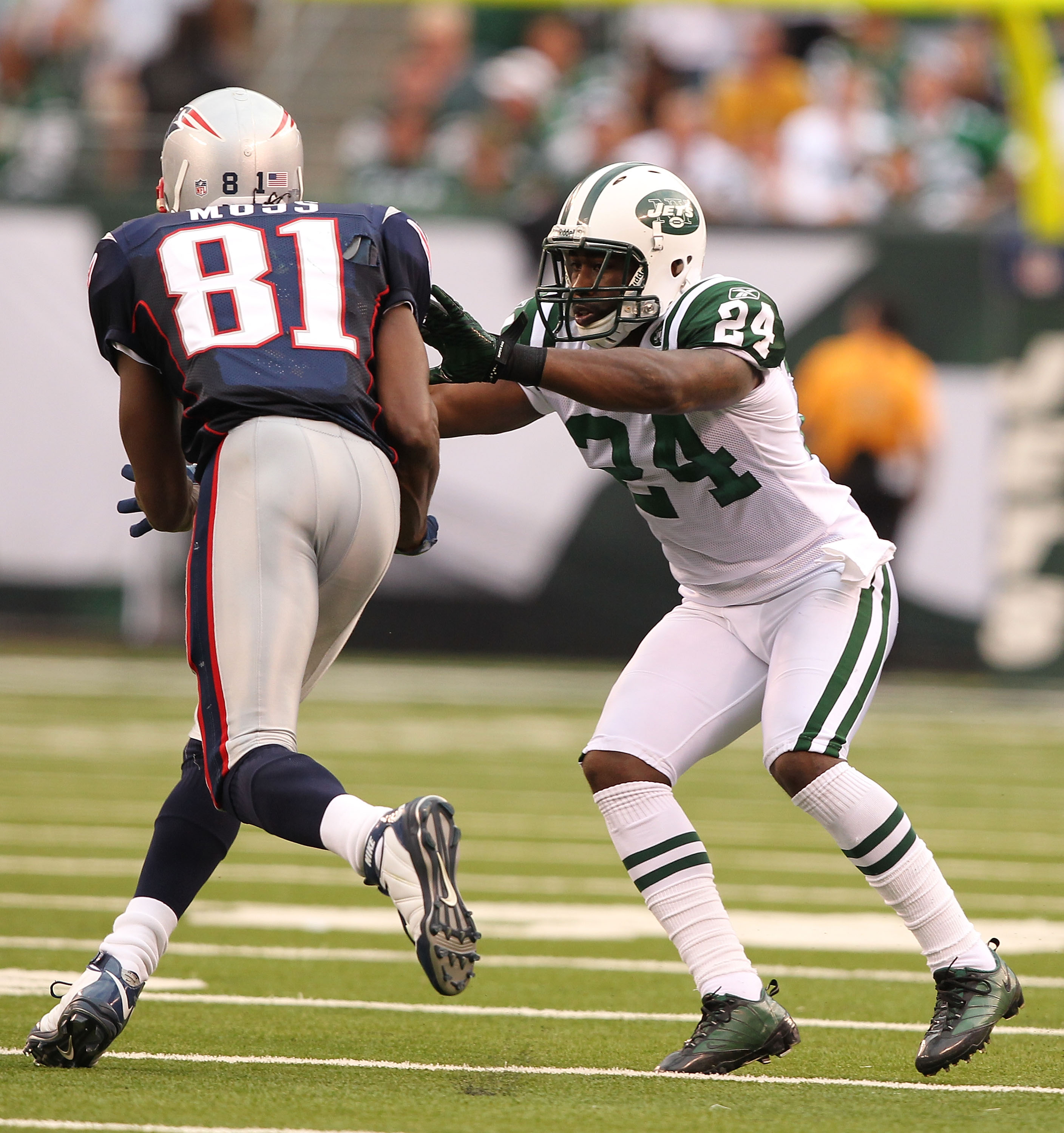 EAST RUTHERFORD, NJ - SEPTEMBER 19:  Darrelle Revis #24 of the New York Jets defends against Randy Moss #81 of the New England Patriots during their  game on September 19, 2010 at the New Meadowlands Stadium  in East Rutherford, New Jersey.  (Photo by Al