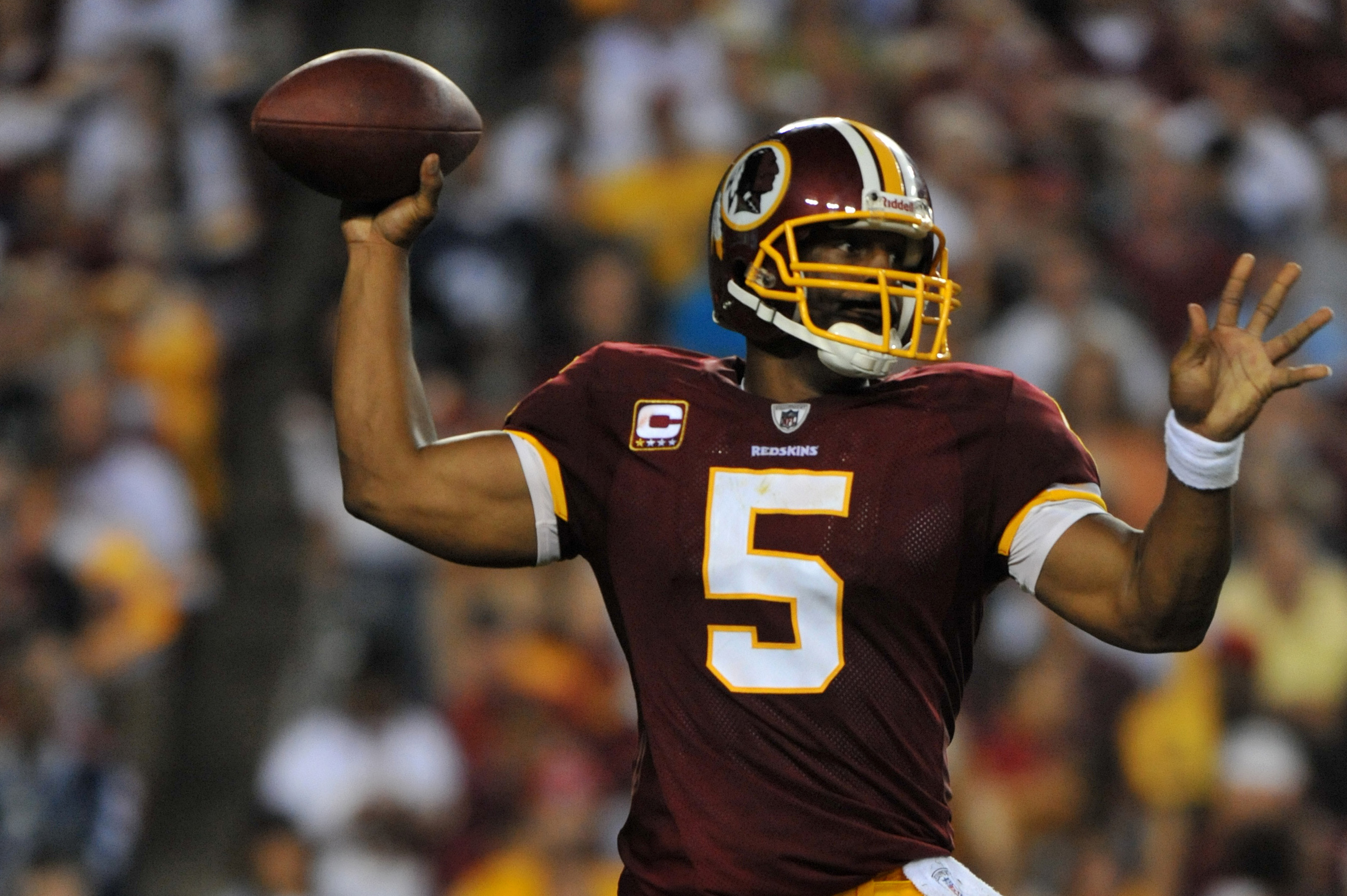 LANDOVER - SEPTEMBER 12:  Donovan McNabb #5 of the Washington Redskins passes during the NFL season opener against the Dallas Cowboys at FedExField on September 12, 2010 in Landover, Maryland. The Redskins defeated the Cowboys 13-7. (Photo by Larry French