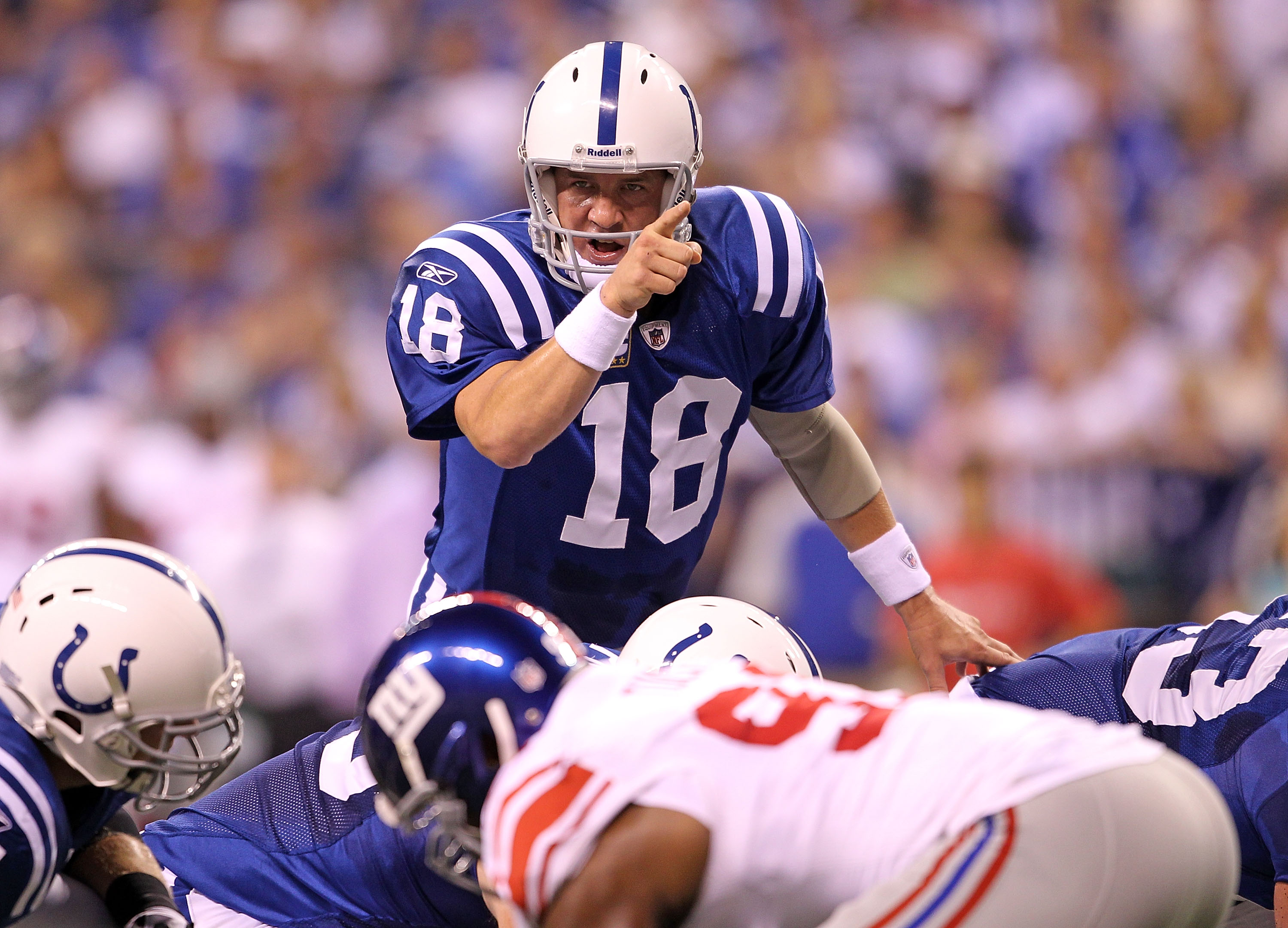 INDIANAPOLIS - SEPTEMBER 19:  Peyton Manning #18 of the Indianapolis Colts gives instructions to his team during  the NFL game against the New York Giants  at Lucas Oil Stadium on September 19, 2010 in Indianapolis, Indiana.  (Photo by Andy Lyons/Getty Im