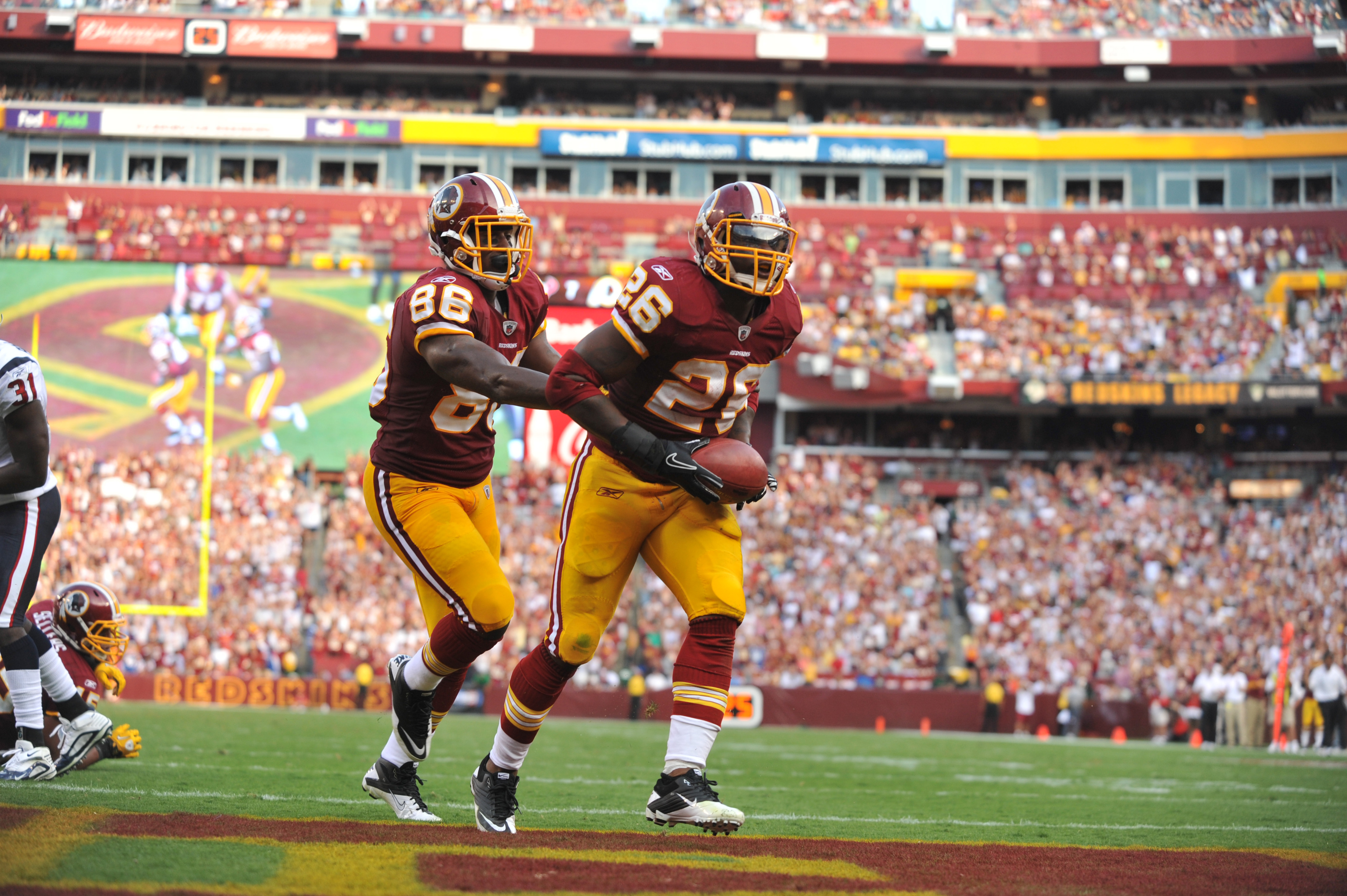 LANDOVER, MD - SEPTEMBER 19:  Clinton Portis #26 of the Washington Redskins celebrates a touchdown against the Houston Texans at FedExField on September 19, 2010 in Landover, Maryland. The Redskins lead the Texans at the half 20-7. (Photo by Larry French/