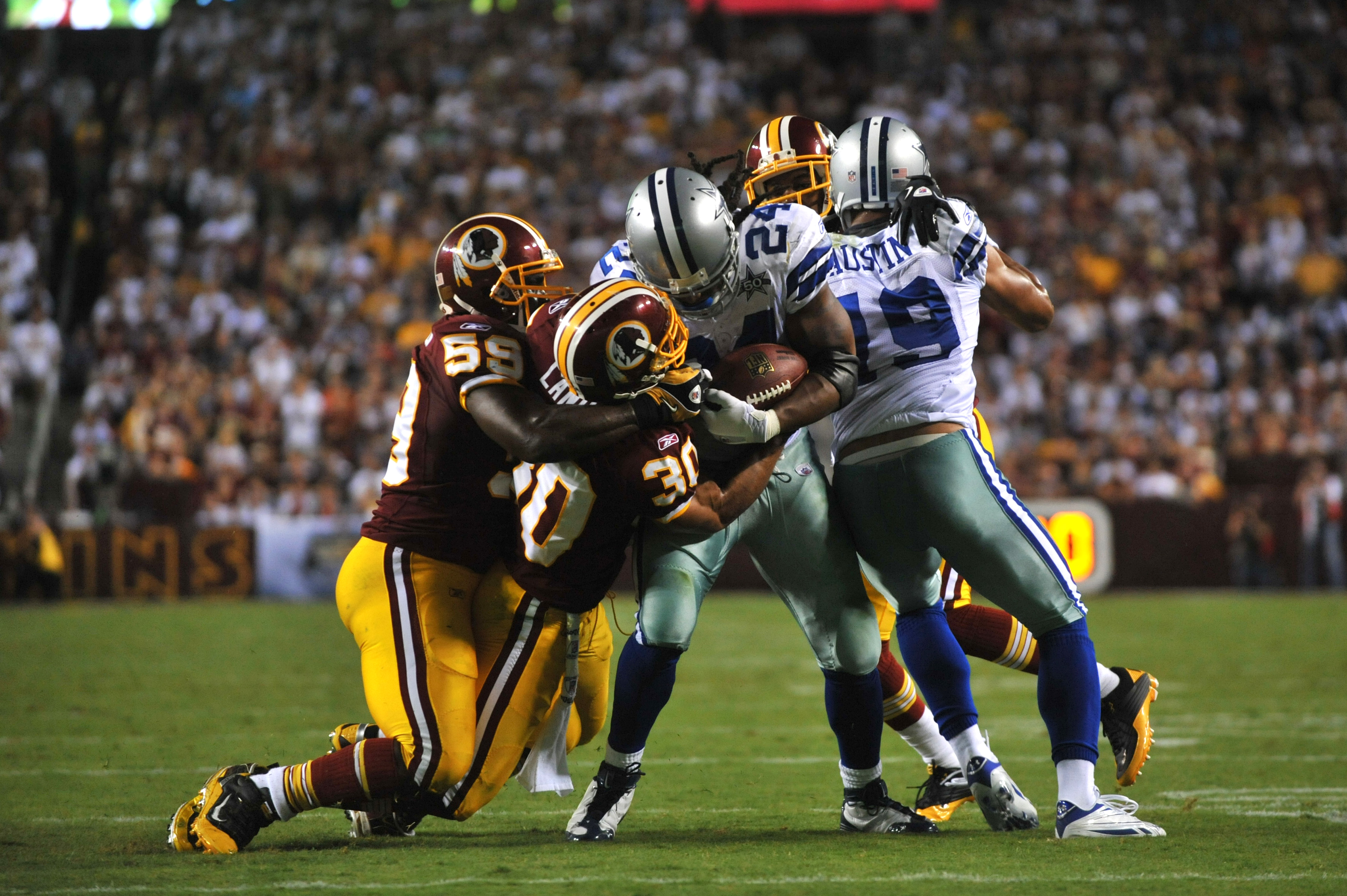 LANDOVER - SEPTEMBER 12:  London Fletcher #59 of the Washington Redskins makes a tackle during the NFL season opener against the Dallas Cowboys at FedExField on September 12, 2010 in Landover, Maryland. The Redskins defeated the Cowboys 13-7. (Photo by La