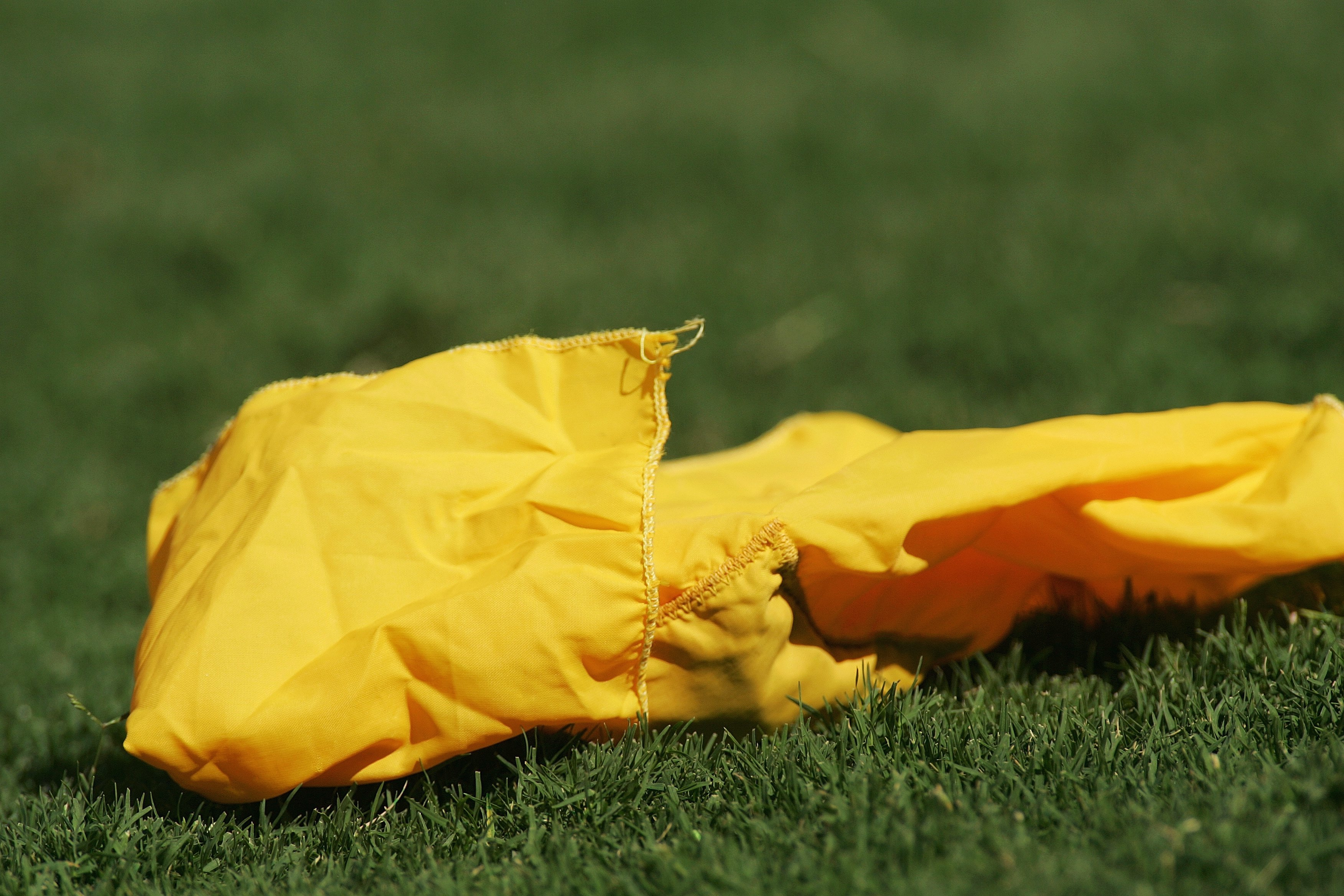 DALLAS - OCTOBER 7:  Detail of the yellow flag thrown by a referee during the Red River Shootout between the Texas Longhorns and the Oklahoma Sooners at the Cotton Bowl on October 7, 2006 in Dallas, Texas. The Longhorns won 28-10. (Photo by Ronald Martine