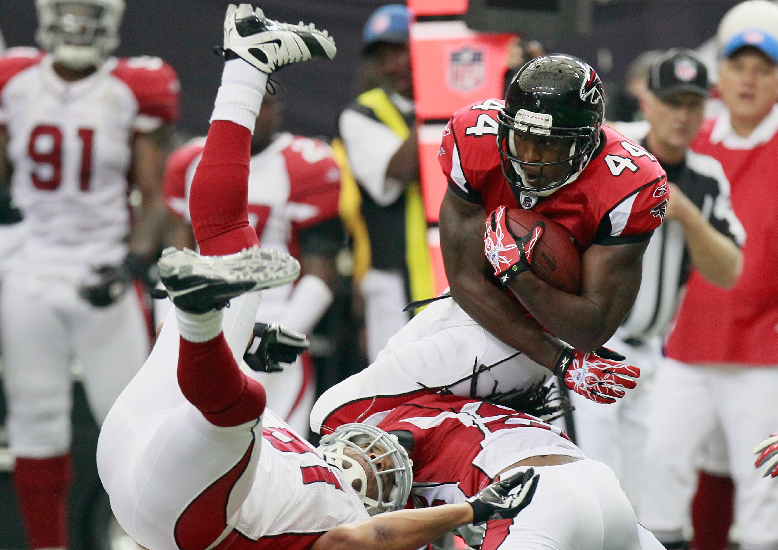 ATLANTA - SEPTEMBER 19:  Jason Snelling #44 of the Atlanta Falcons dives for more yardage against the Arizona Cardinals at Georgia Dome on September 19, 2010 in Atlanta, Georgia.  (Photo by Kevin C. Cox/Getty Images)