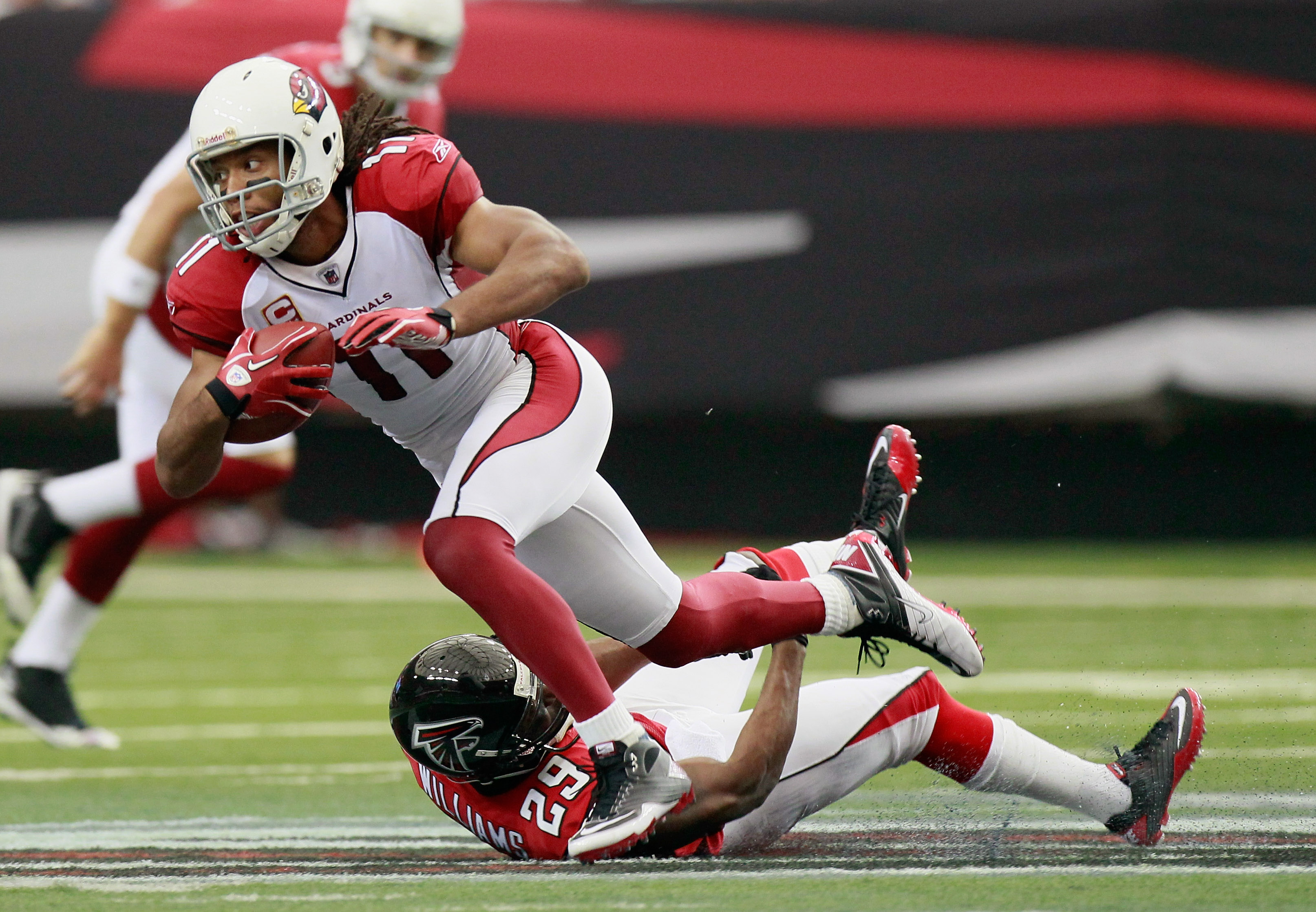 ATLANTA - SEPTEMBER 19:  Larry Fitzgerald #11 of the Arizona Cardinals is tackled by Brian Williams #29 of the Atlanta Falcons at Georgia Dome on September 19, 2010 in Atlanta, Georgia.  (Photo by Kevin C. Cox/Getty Images)