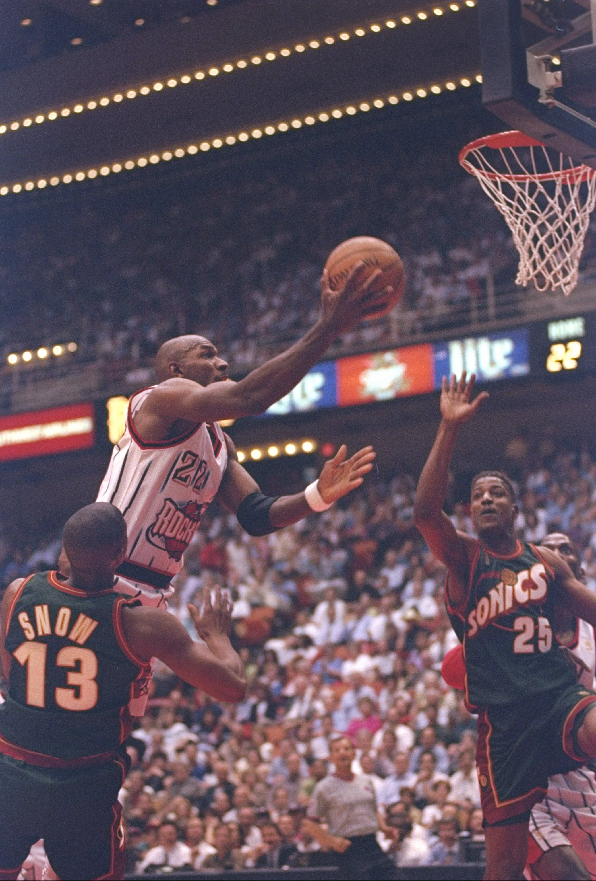 13 May 1997:  Forward Clyde Drexler of the Houston Rockets flies to the basket as forward David Wingate and guard Eric Snow of the Seattle Supersonics try to block him during a playoff game at the Summit in Houston, Texas.  The Supersonics won the game 10