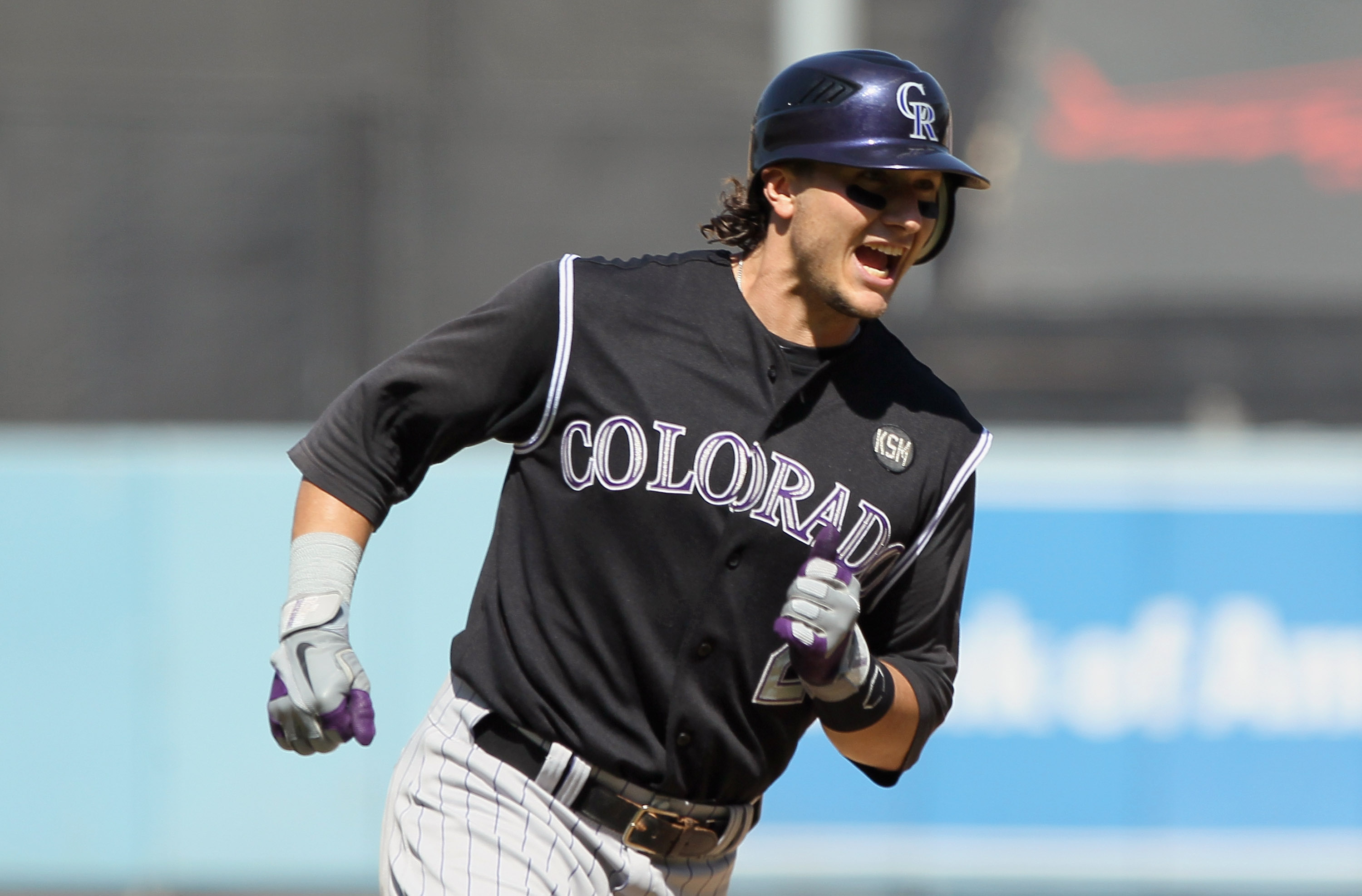 LOS ANGELES, CA - SEPTEMBER 18:  Troy Tulowitzki #2 of the Colorado Rockies celebrates as he rounds third base after hitting his second two-run home run of the game against the Los Angeles Dodgers in the fifth inning at Dodger Stadium on September 18, 201